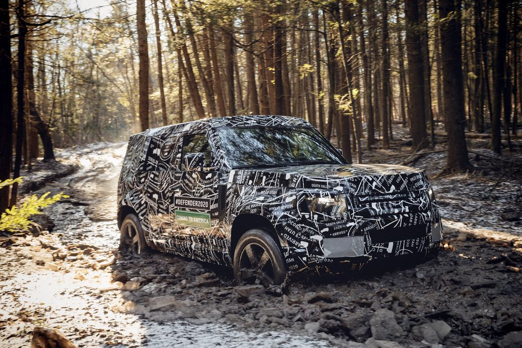 The new Land Rover Defender in camouflage caught on manouveres in the forest