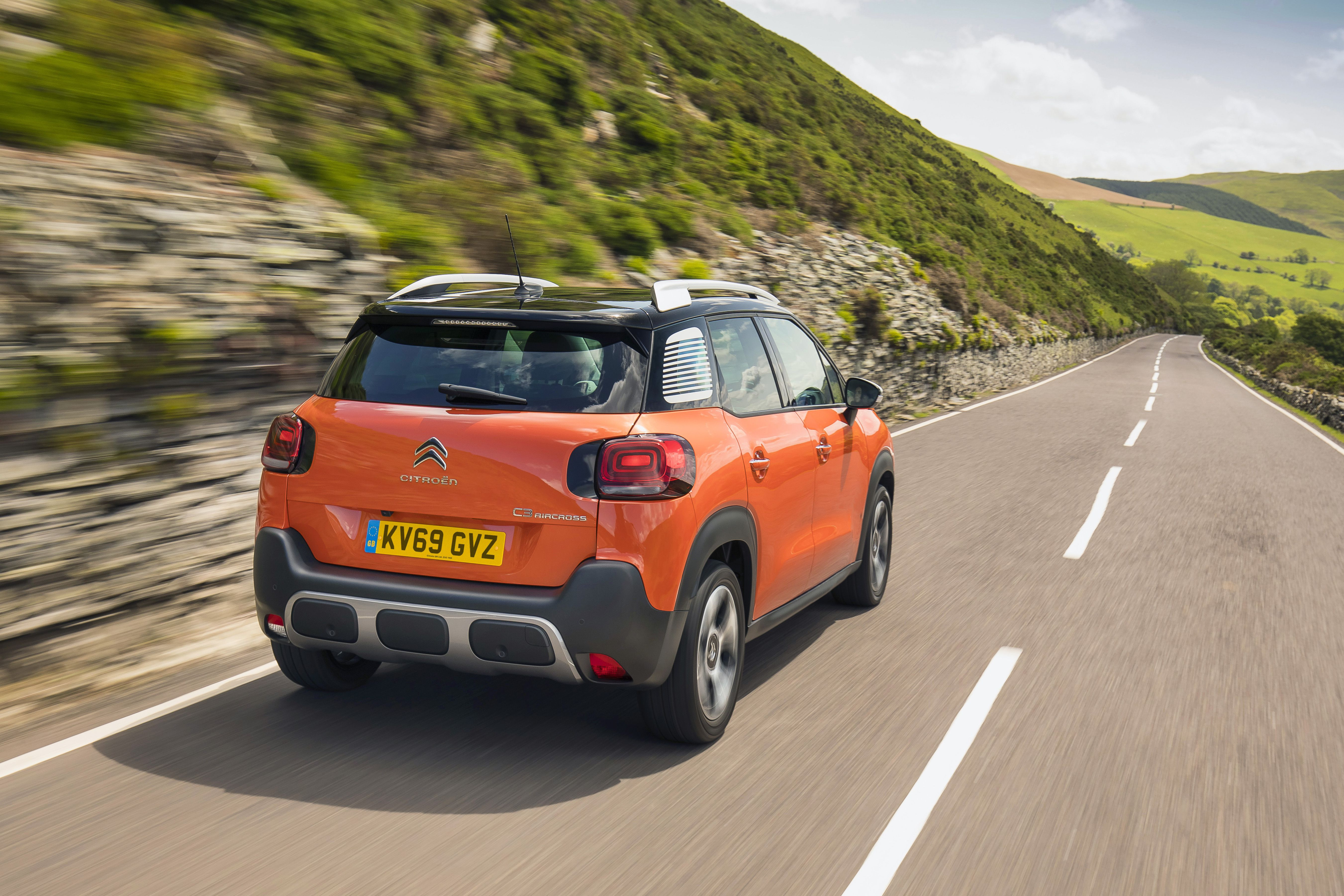 Rear view of an orange Citroen c3 aircross