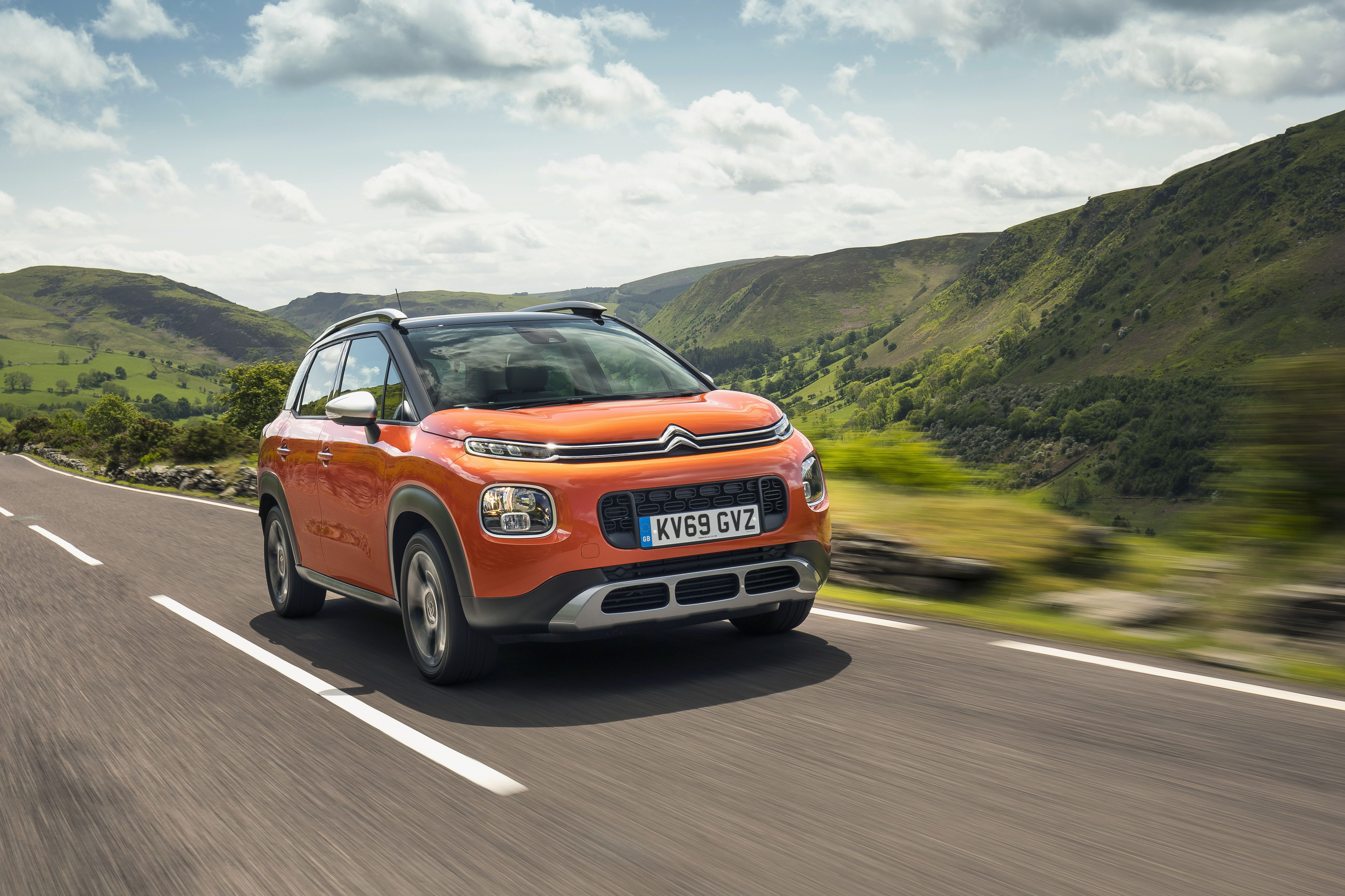 orange Citroen C3 Aircross driving on a road