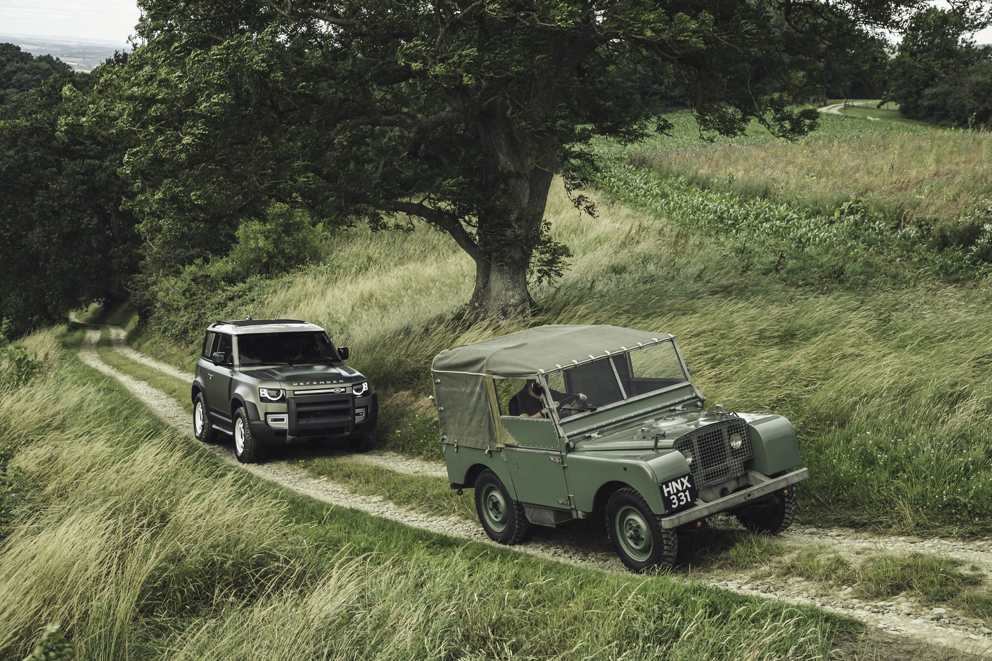 Old and new land rover defender