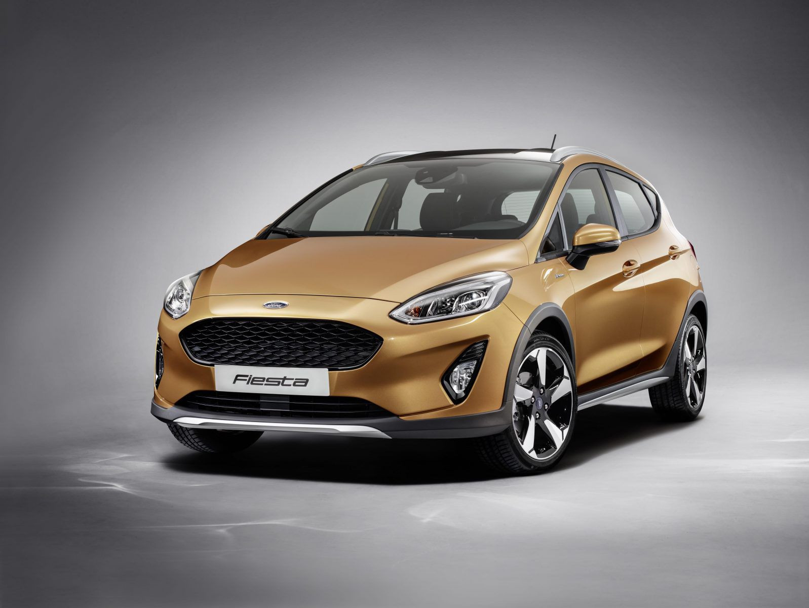 Gold Ford Fiesta 4 door hatchback car
