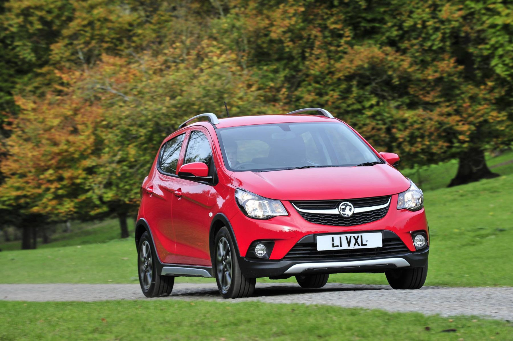 Vauxhall red 4 door hatchback car