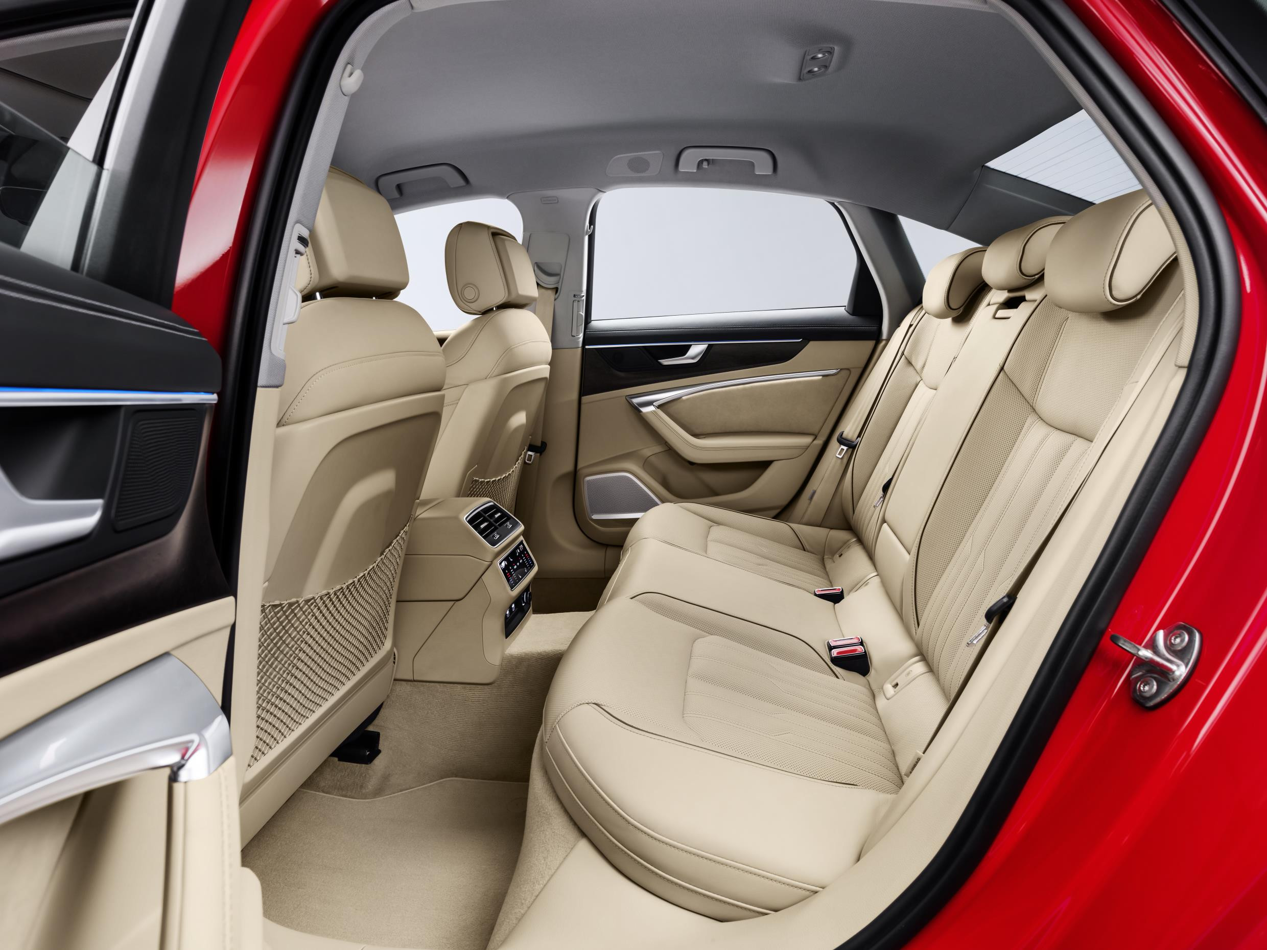 Cream leather rear seats in a red Audi A6