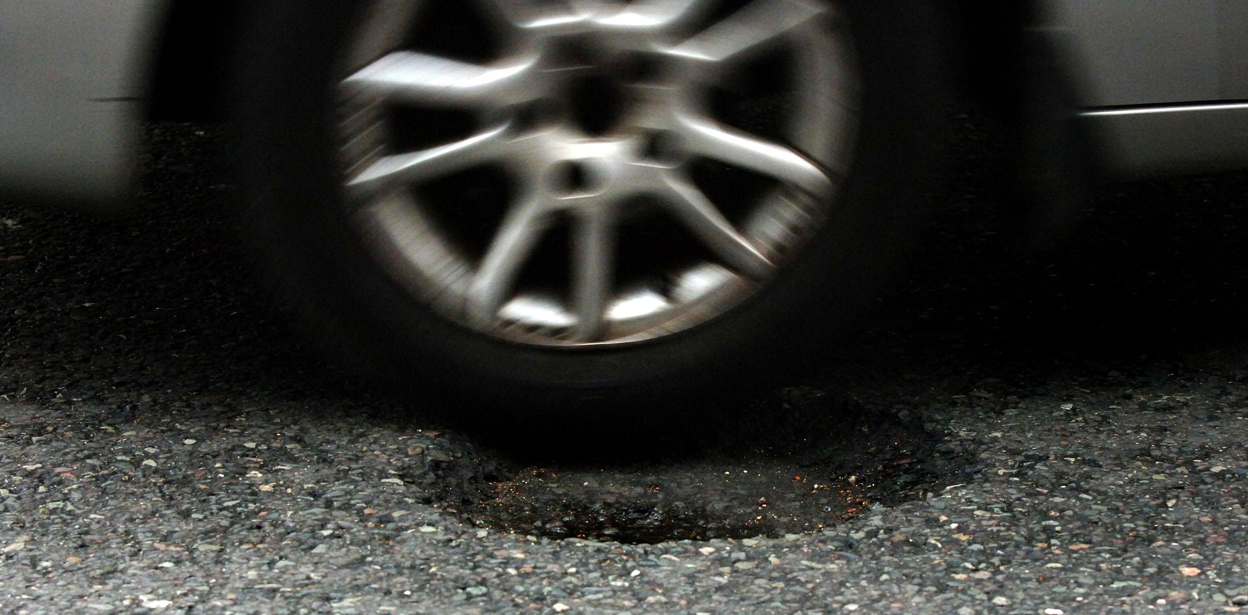How can I claim for pothole damage costs for my car
