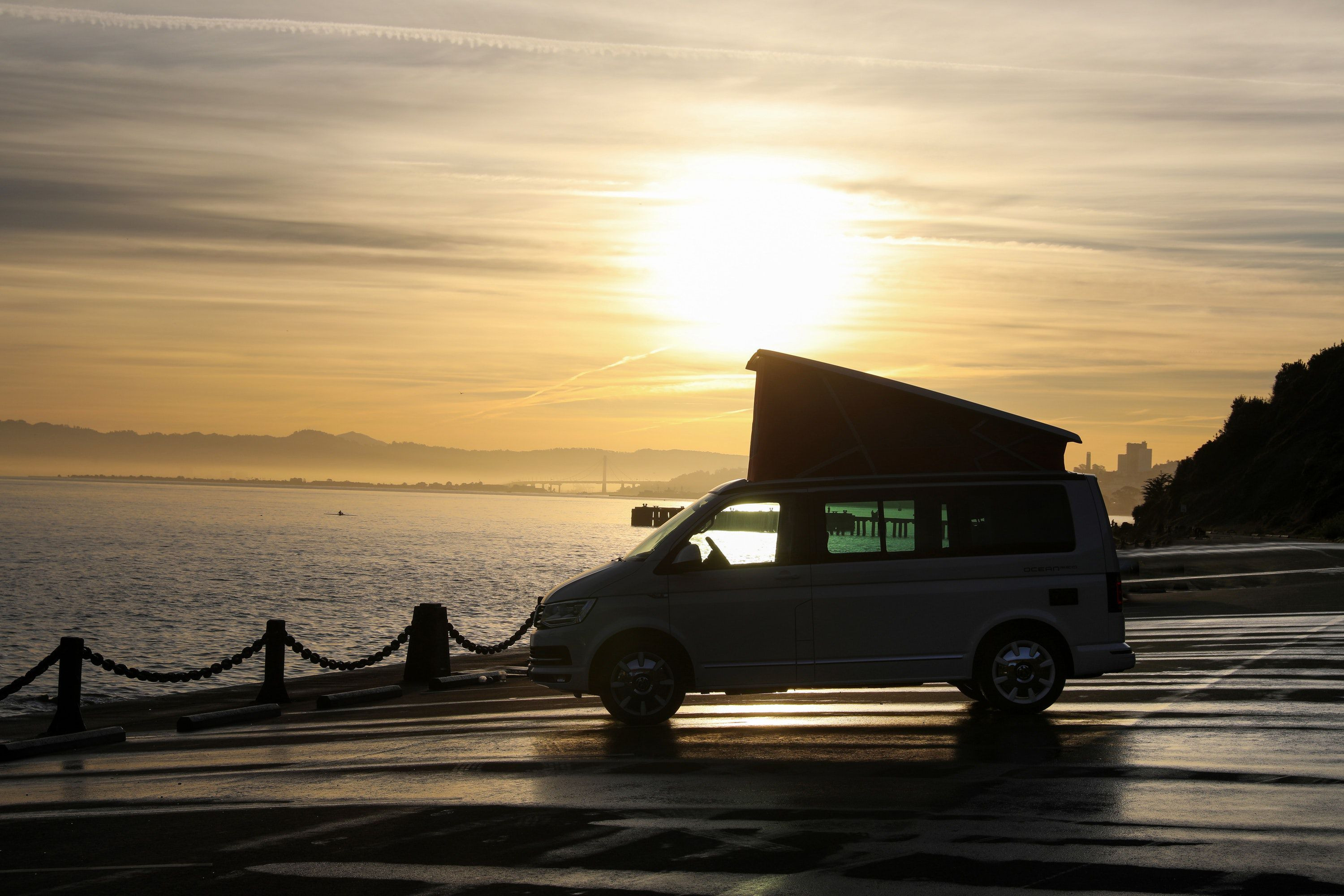 VW California campervan with roof up in sunset