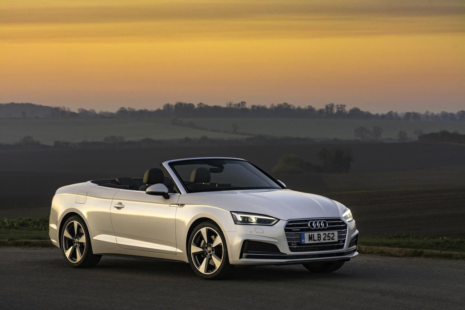 White Audi A5 cabriolet parked two thirds side on at dusk