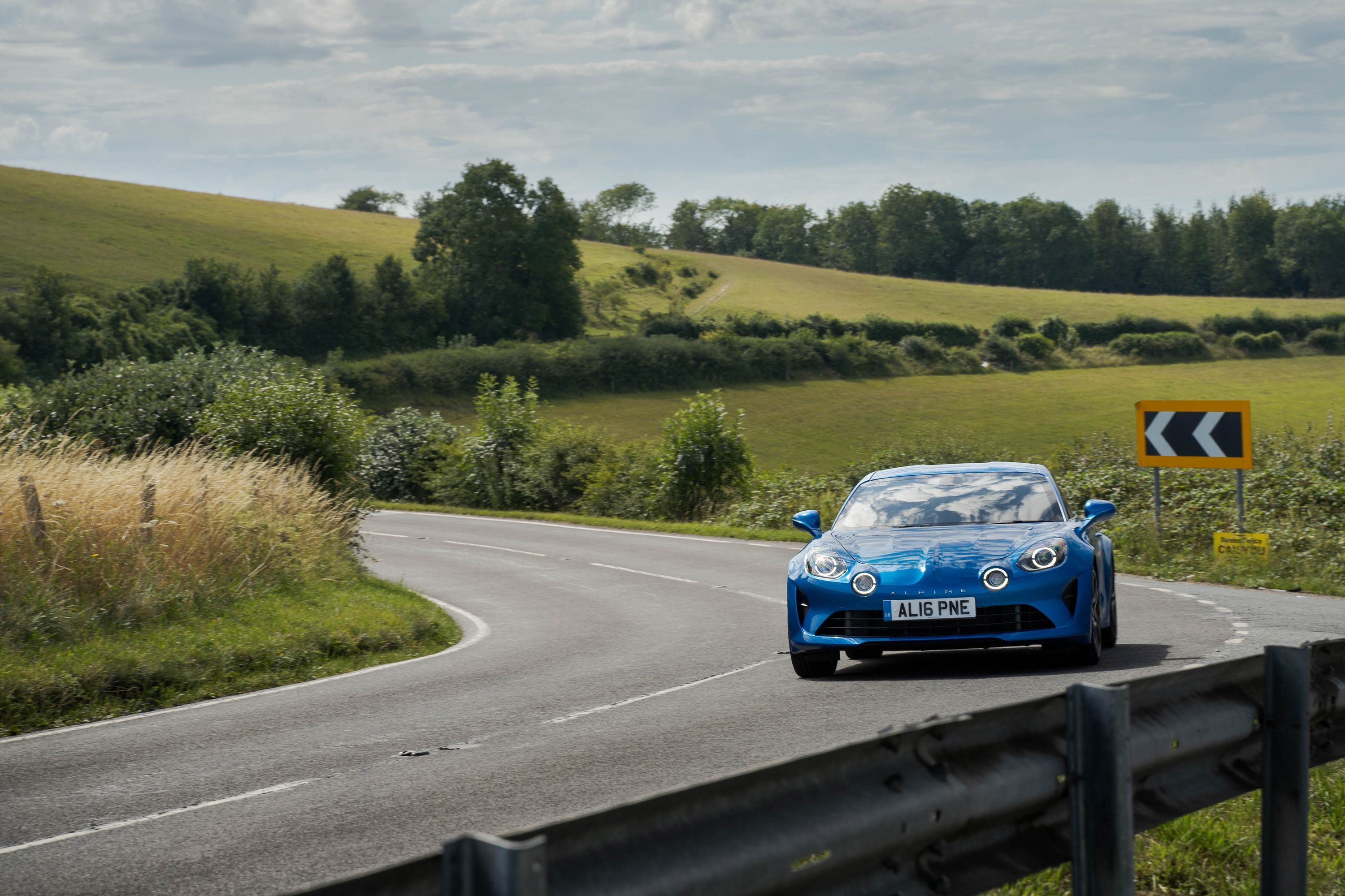 Alpine A110 driving on a road