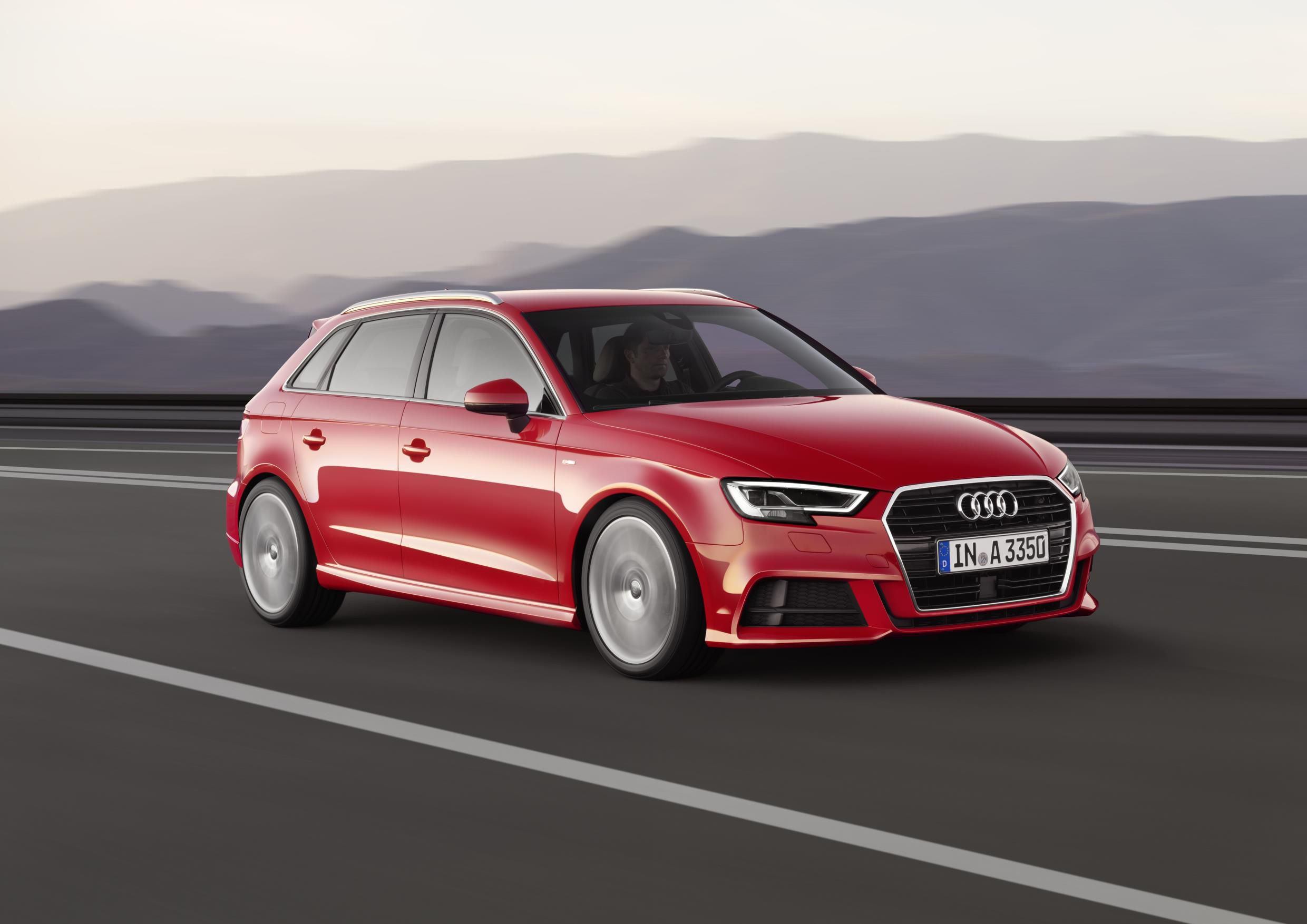Red Audi A3 Sportback driving at speed