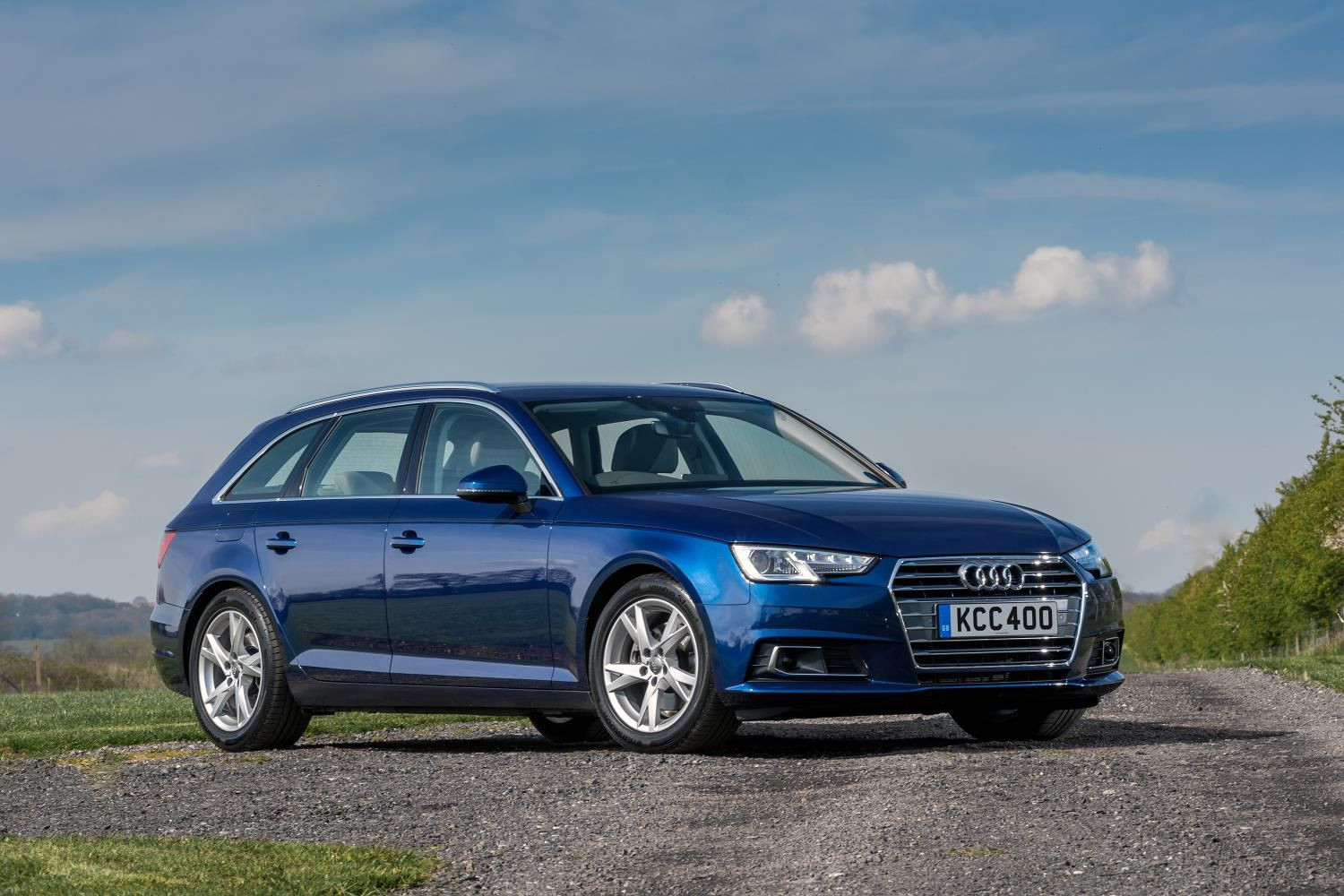 Bark metallic blue Audi A4 Avant parked two thirds side on