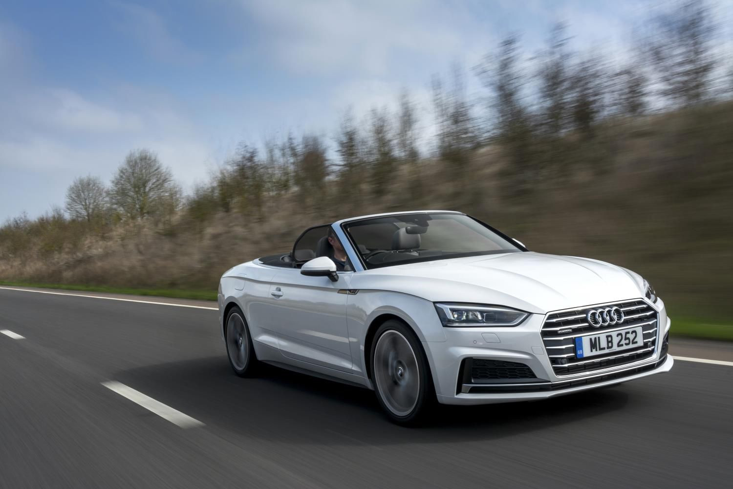 White Audi A5 cabriolet speeding towards you