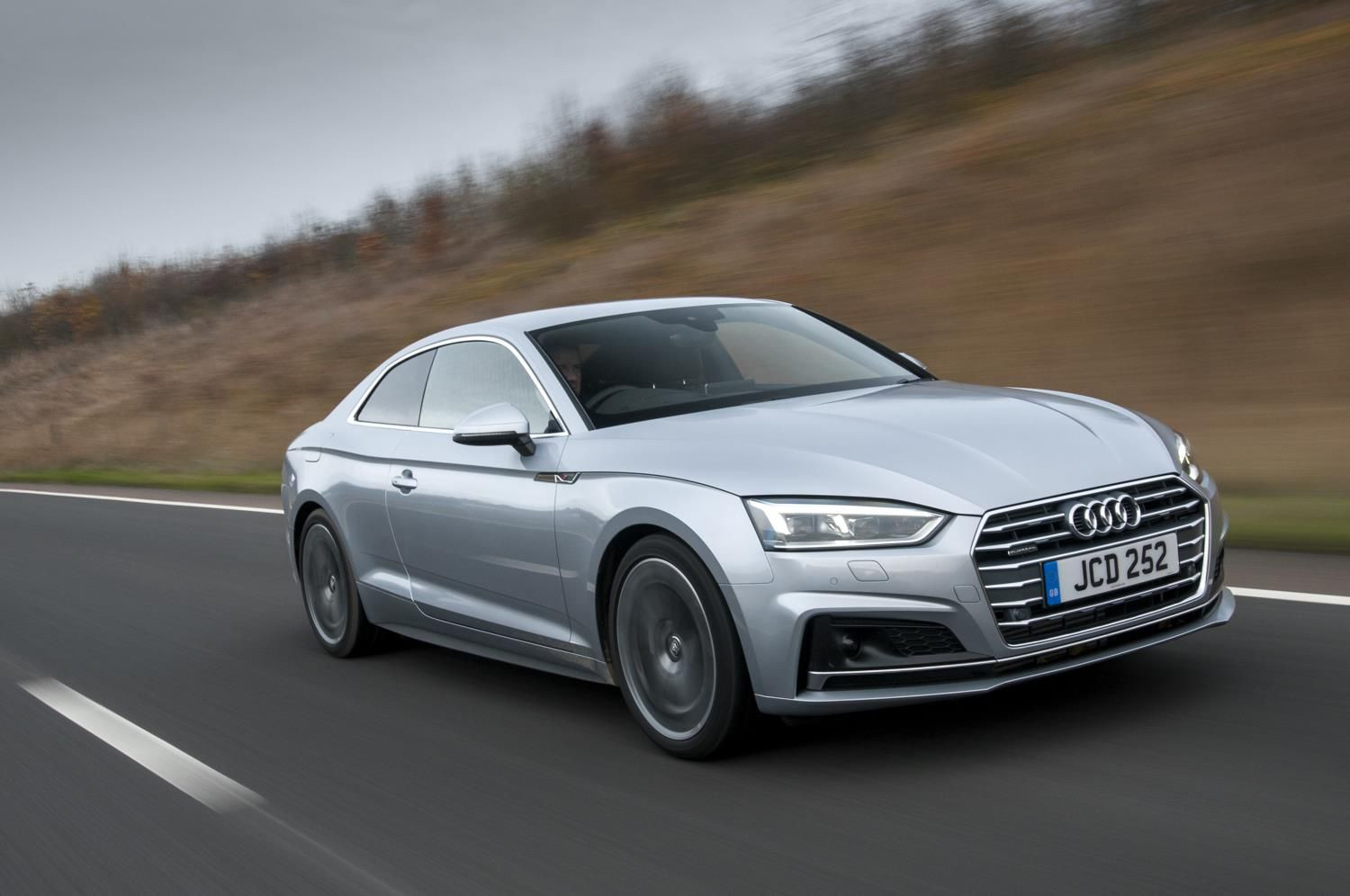 Silver Audi A5 coupe driving towards you at speed