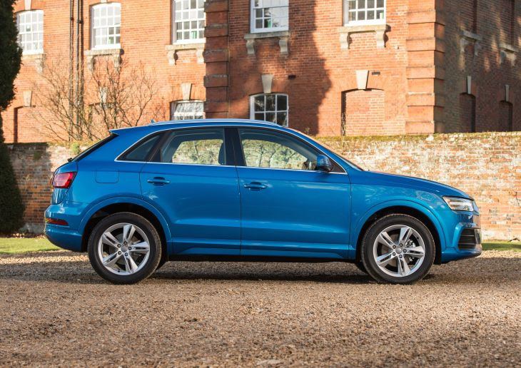 Blue AAudi Q3 side on outside stately home