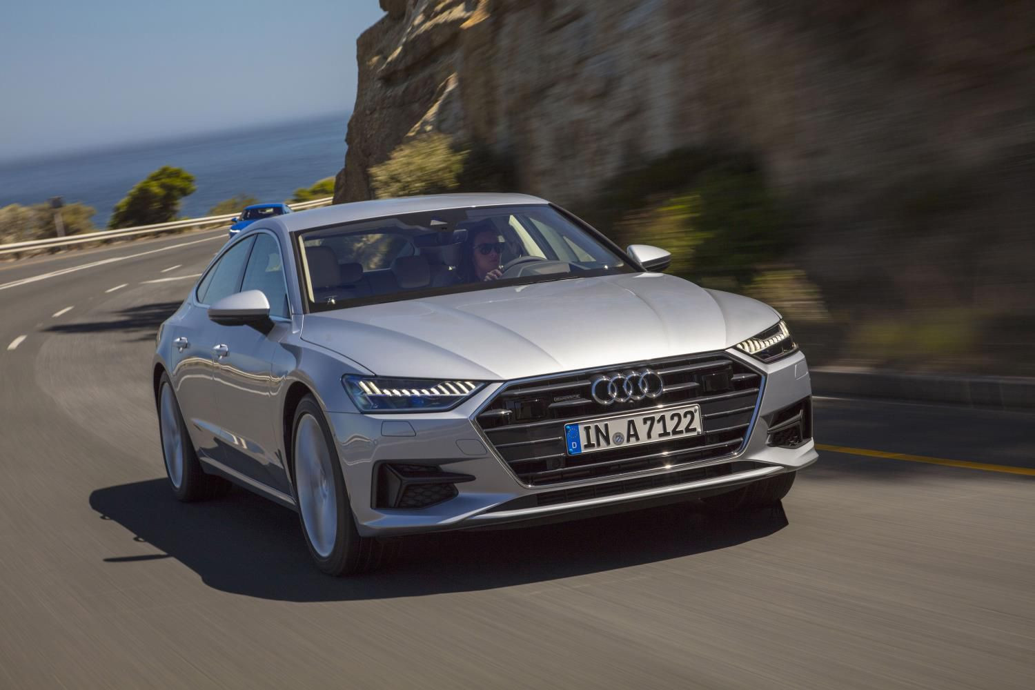Silver Audi A7 sportback driving towards you
