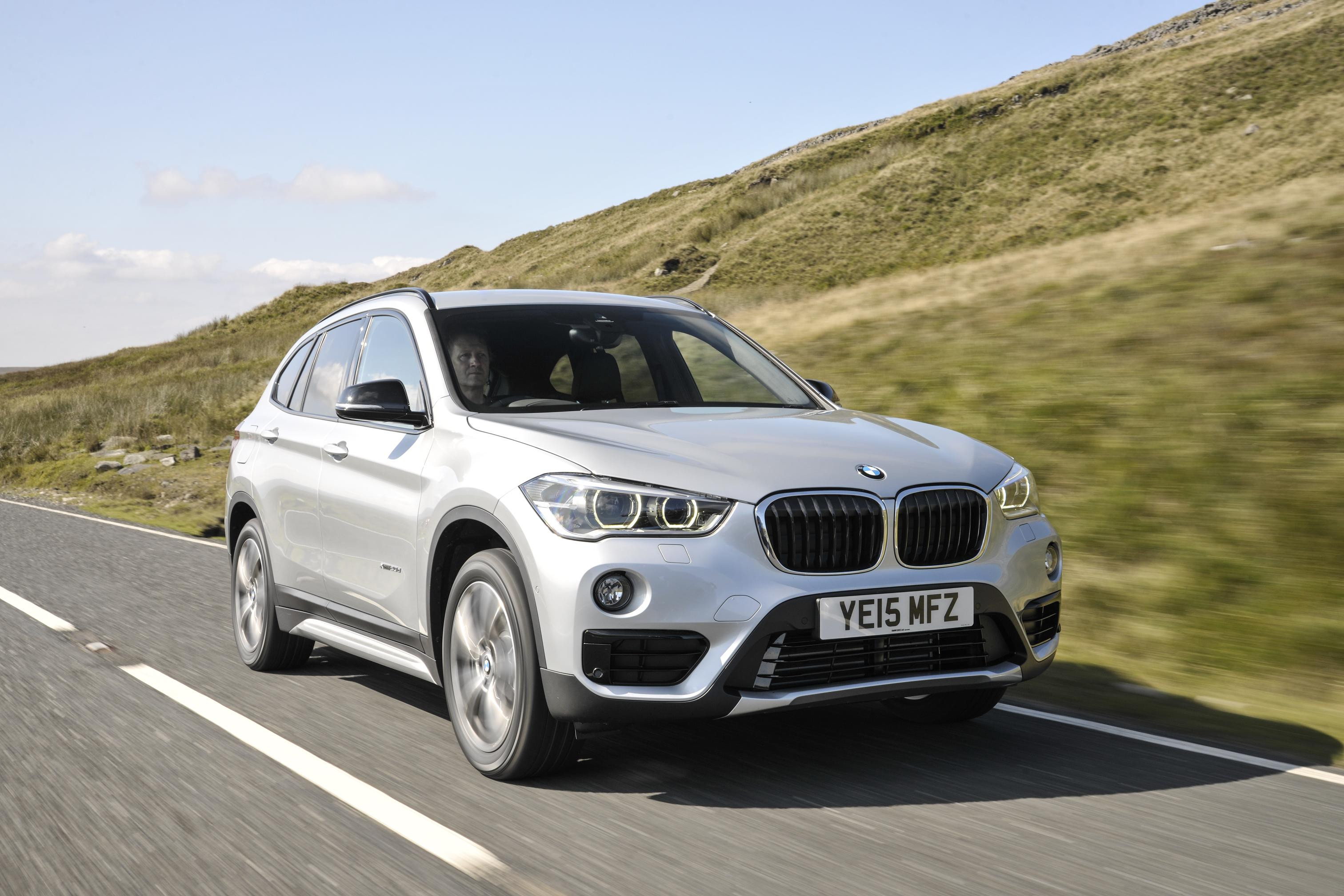 White BMW X1 driving towards you