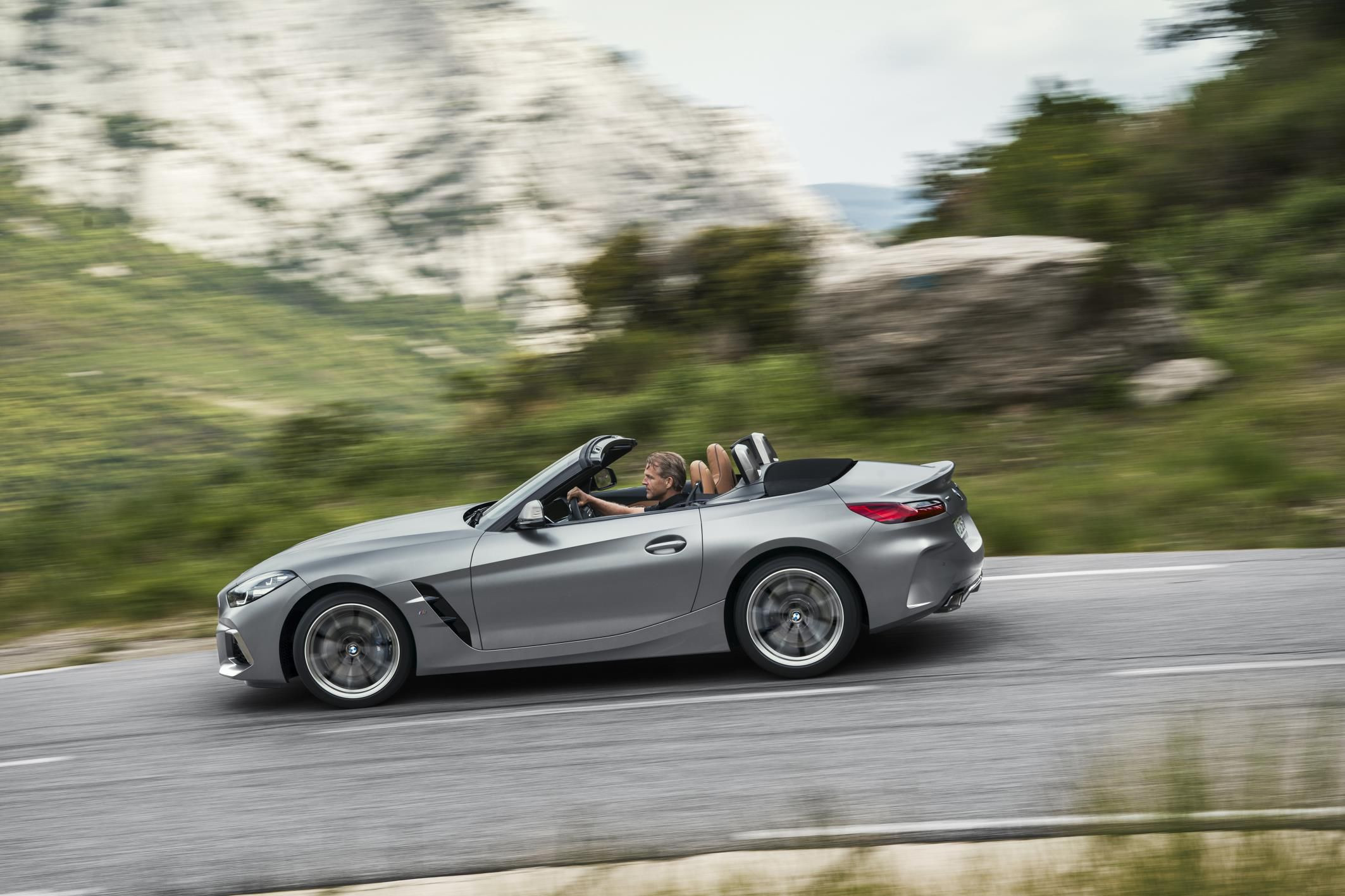 New silver BMW Z$ in rugged countryside