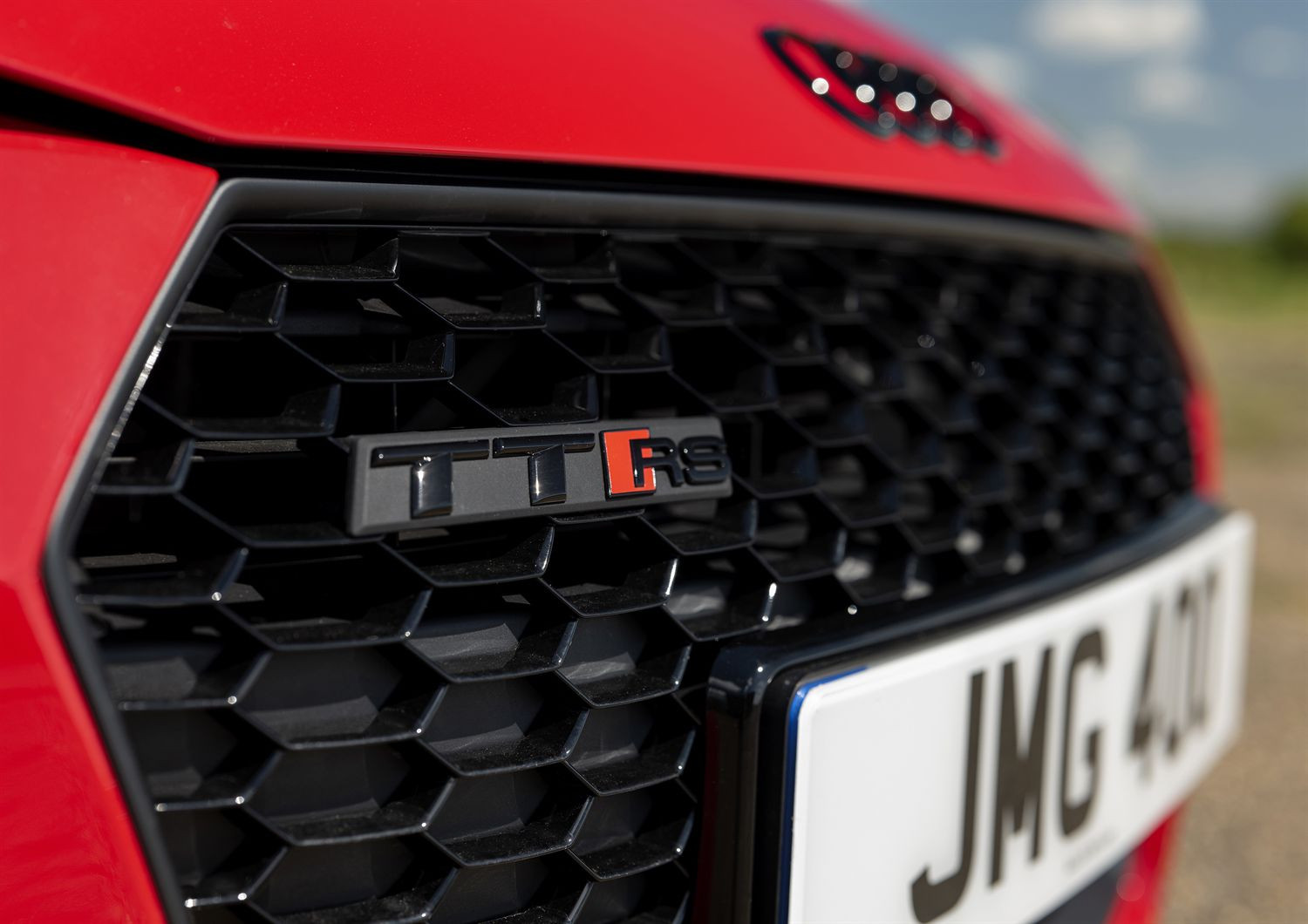 Close up of TT RS badge on the front grille