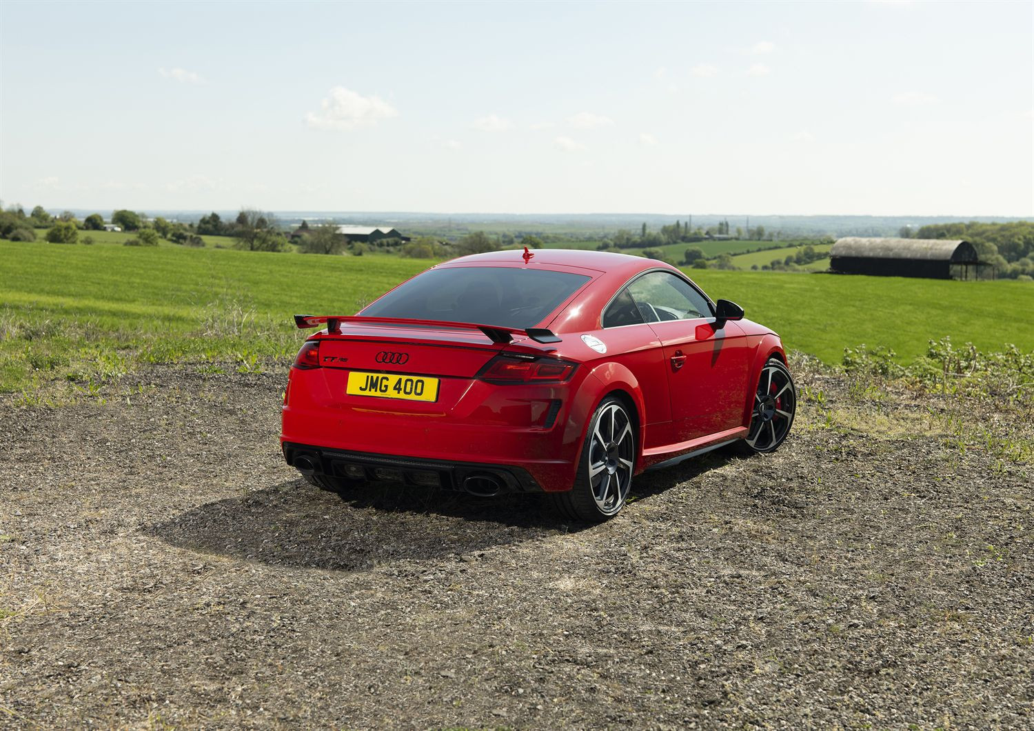 Rear view of a Audi TT RS parked on a field
