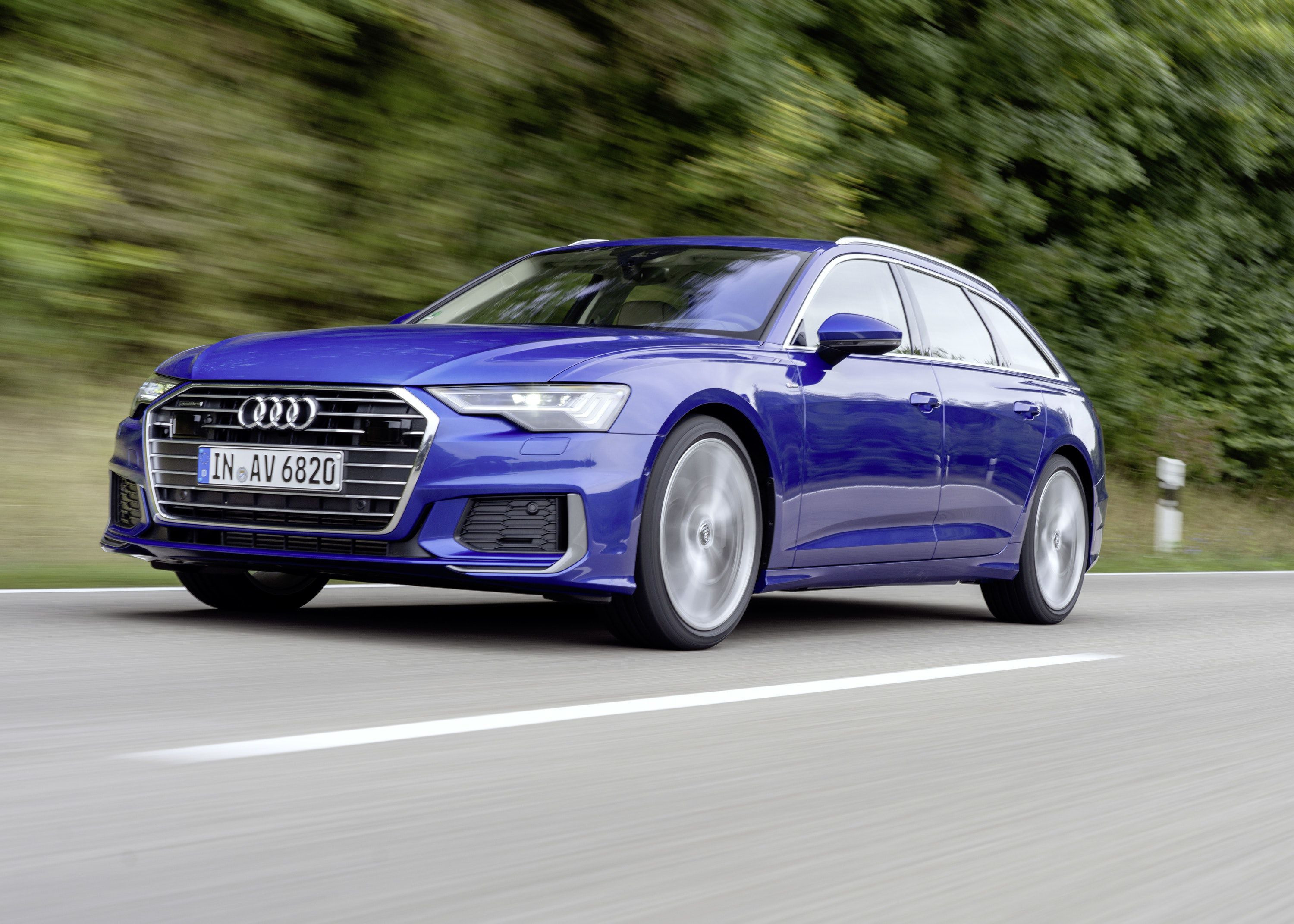 Audi A6 Avant driving on a road