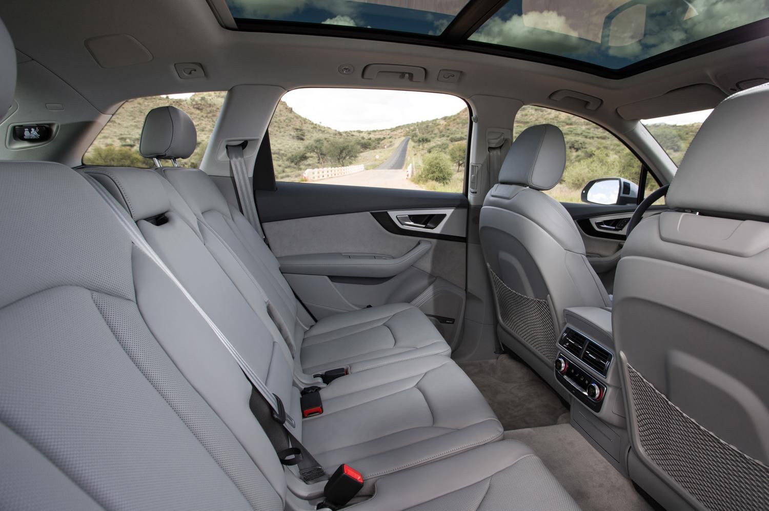 Second row of cream leather and fabric seats in Audi Q7.