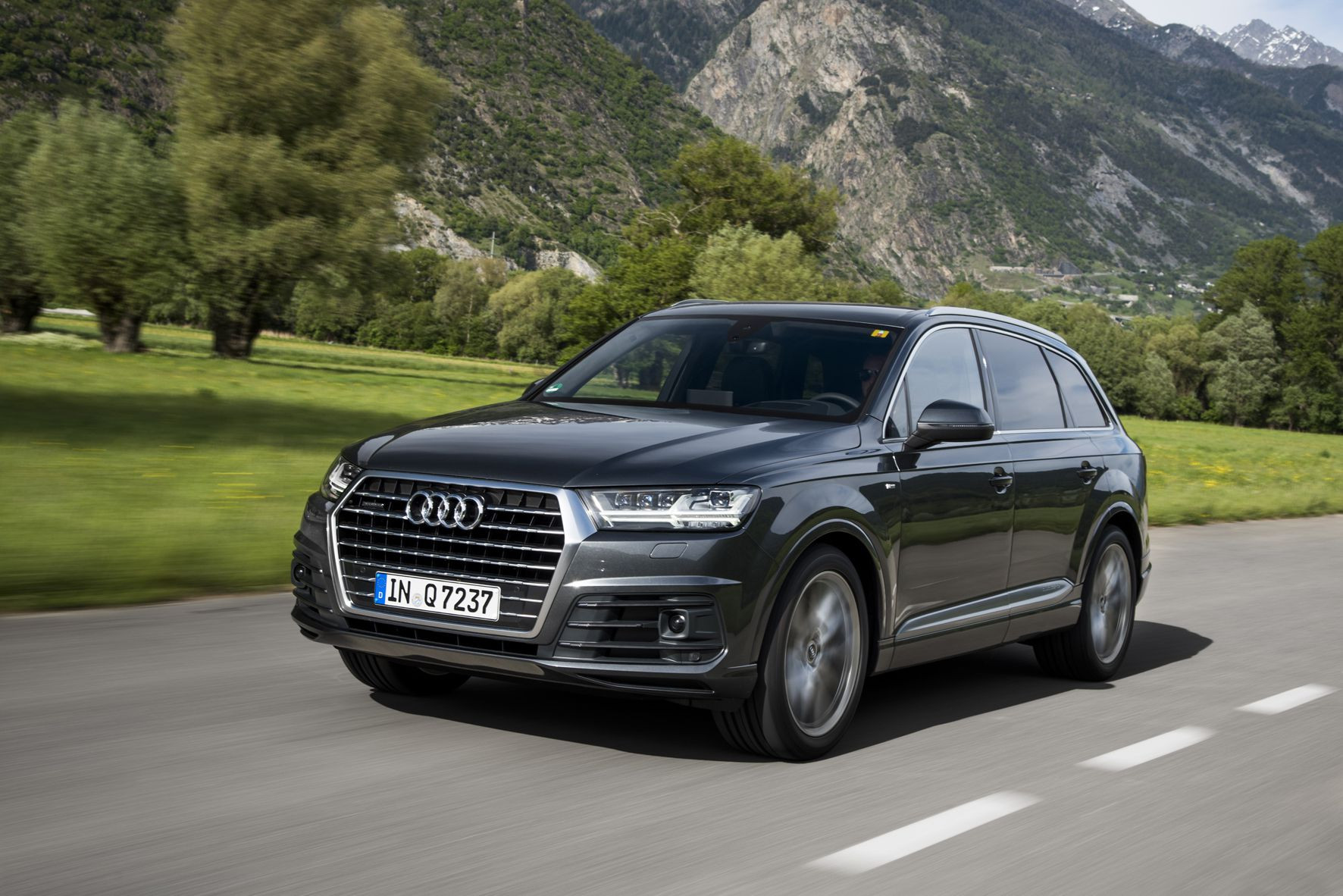 Audi Q7 driving on a road
