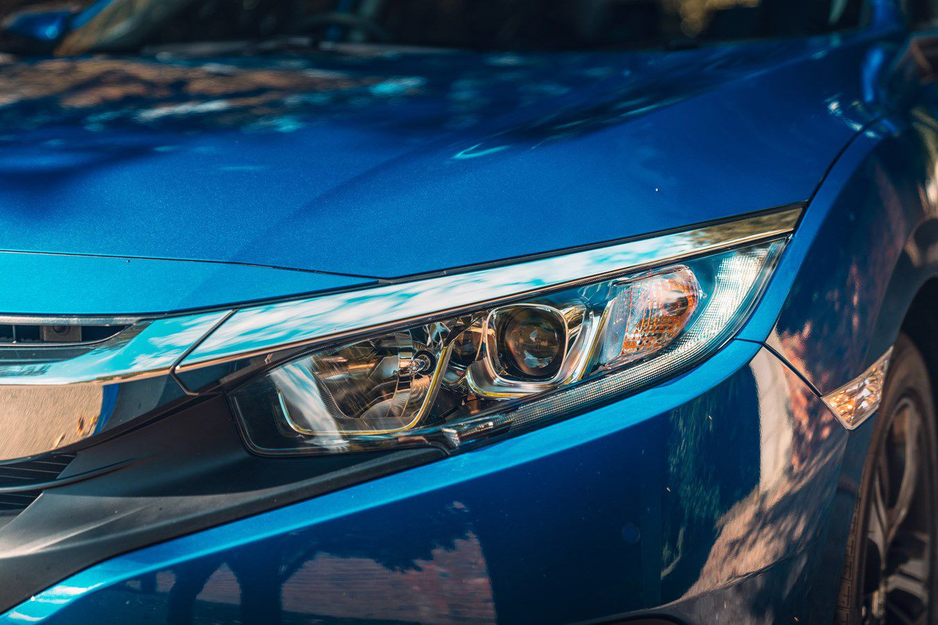 Close up of a headlight on a Honda Civic