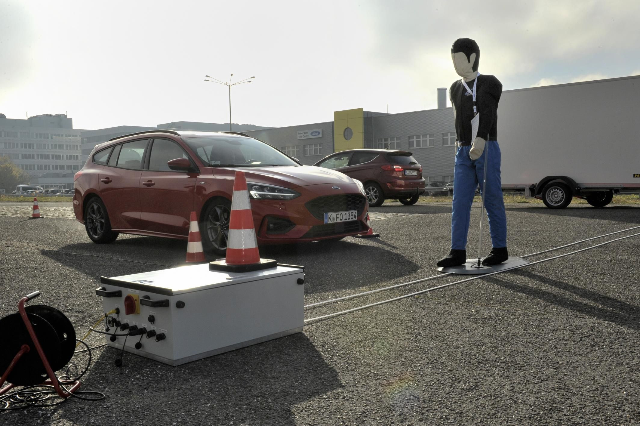 Dummy pedestrian walking in front of car for testing