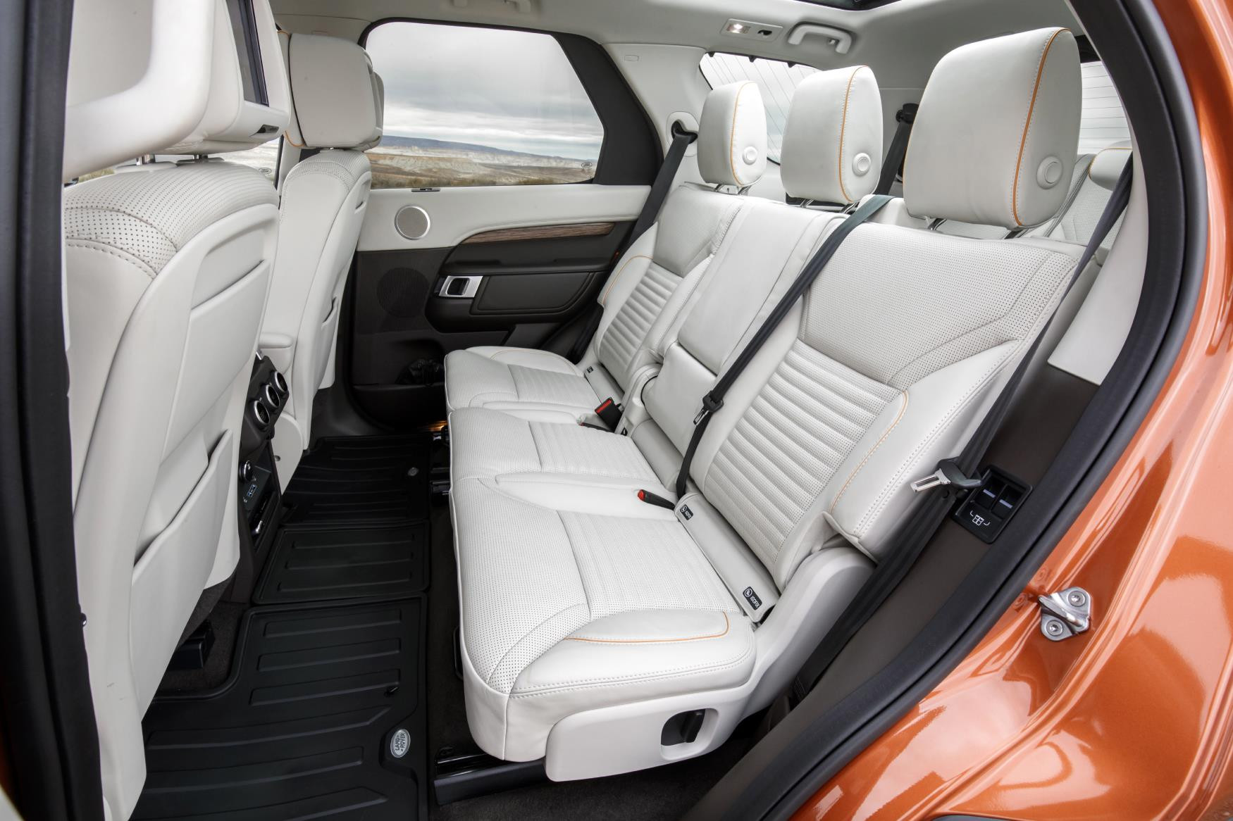 Second row of cream leather seats in Land Rover Discovery