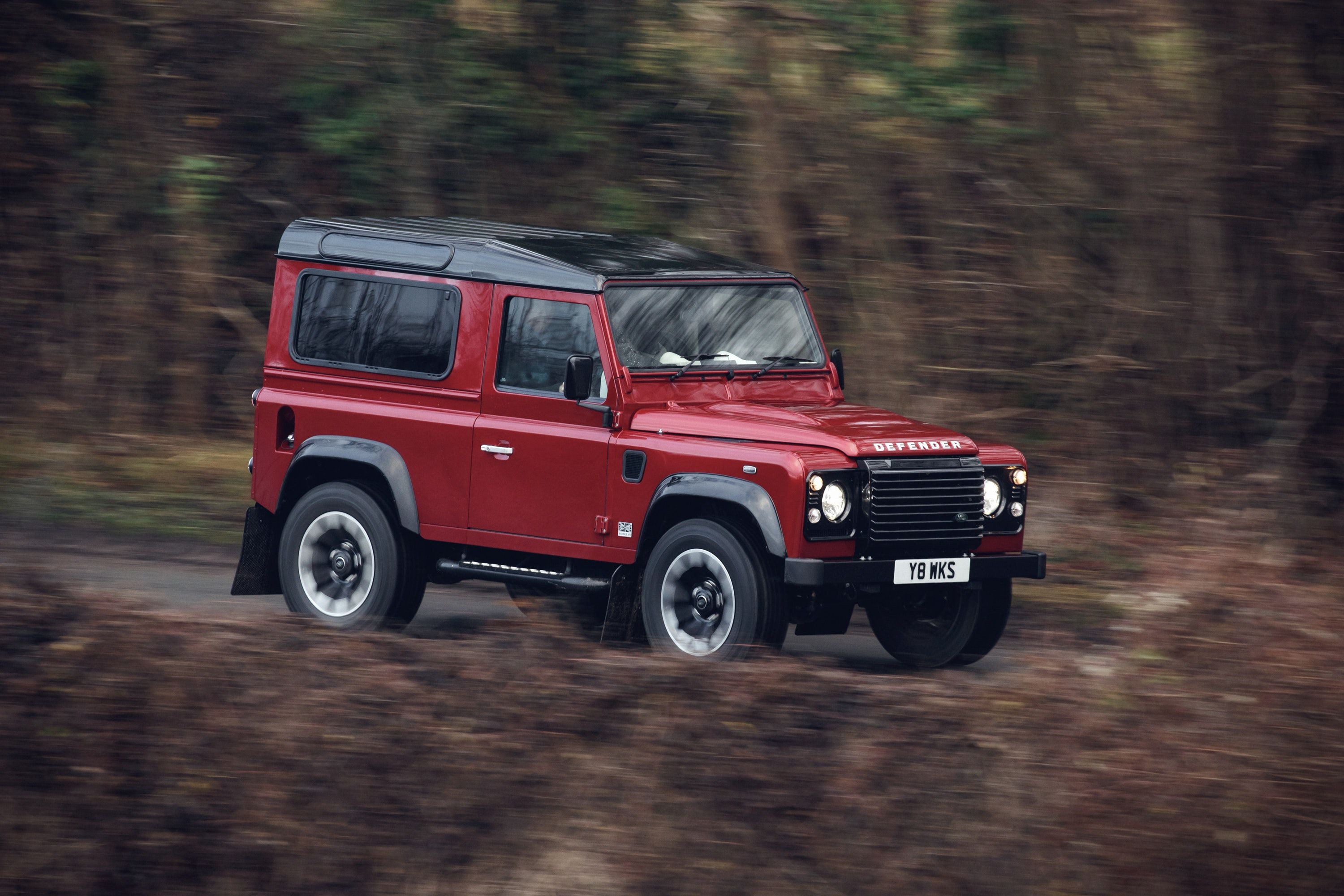 Land rover Defender driving through trees