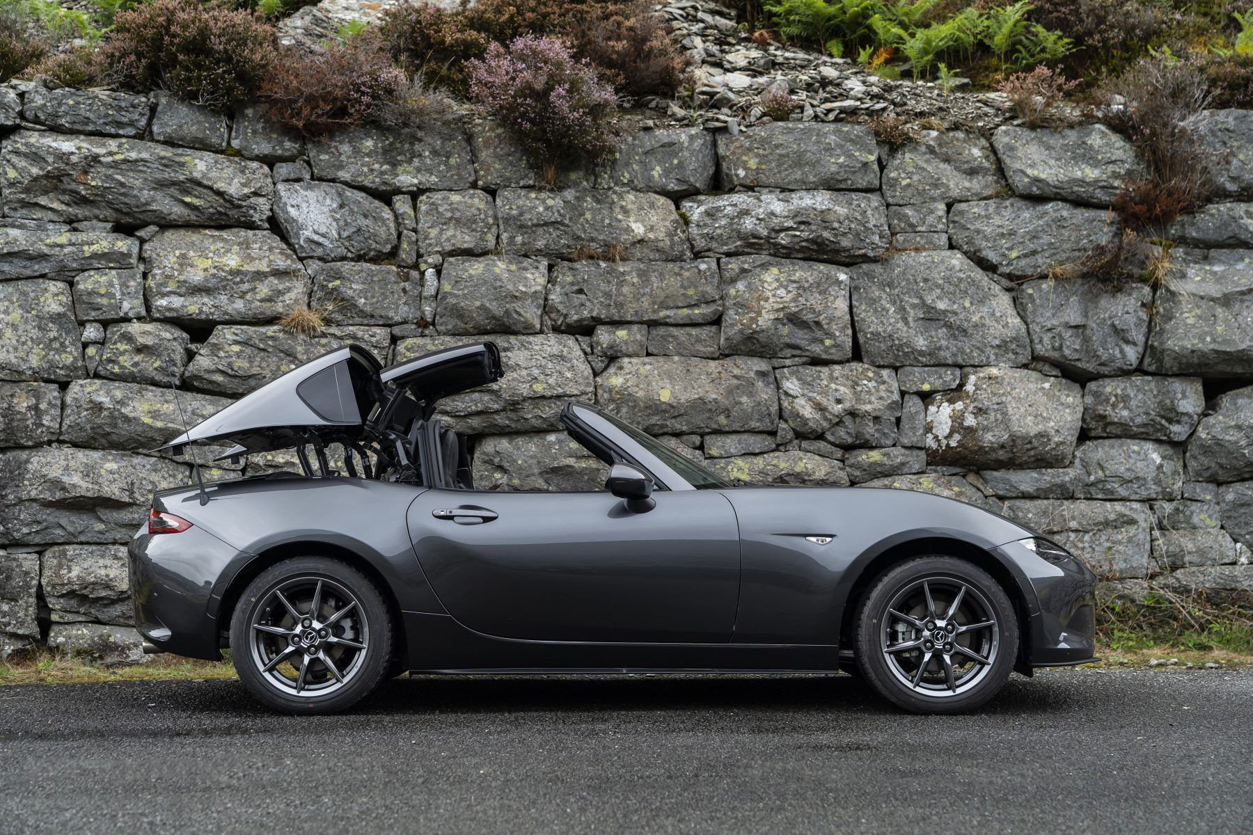 Side view of grey Mazda MX-5 RF with the roof being folded down