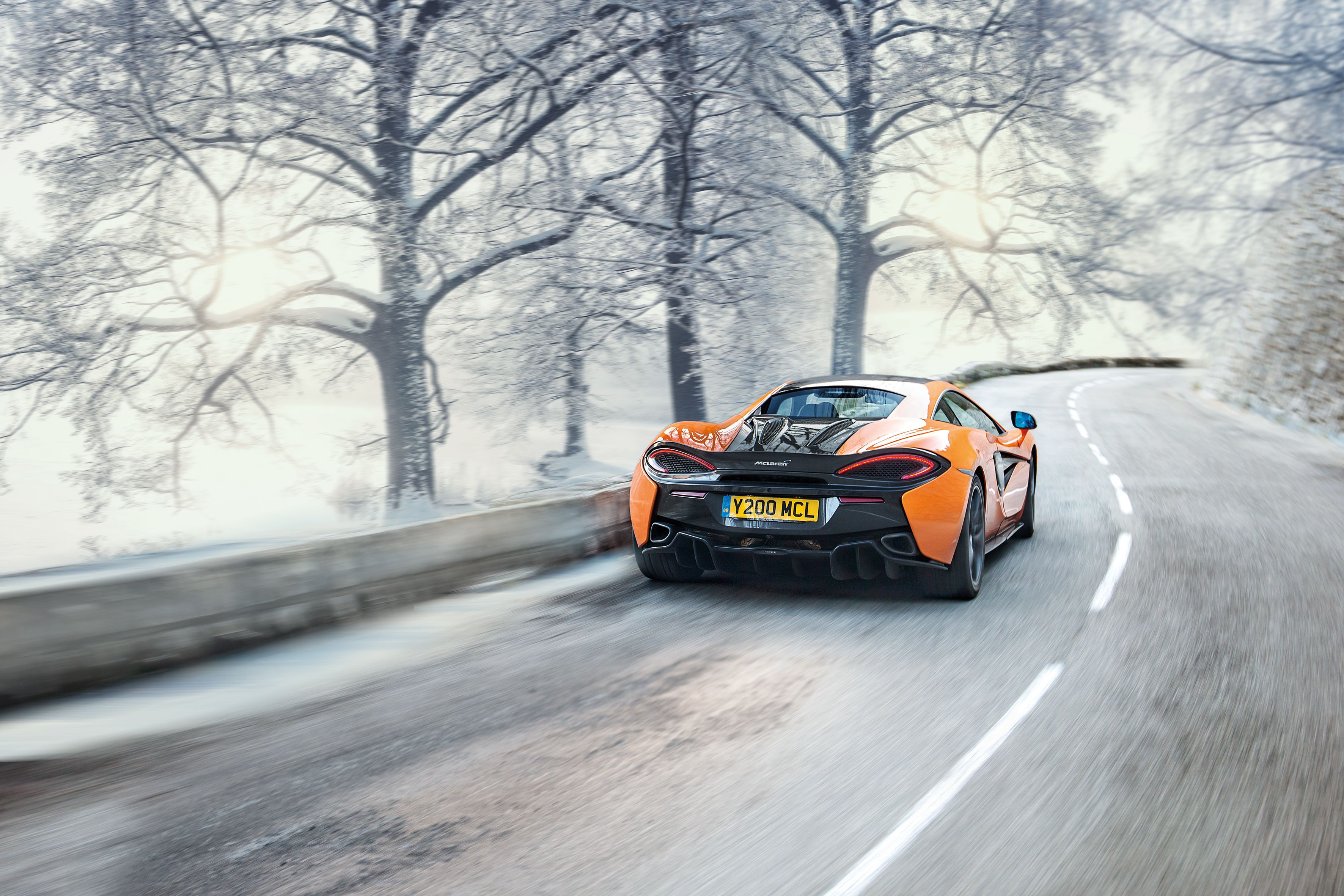 Mclaren driving on frosty and snowy road