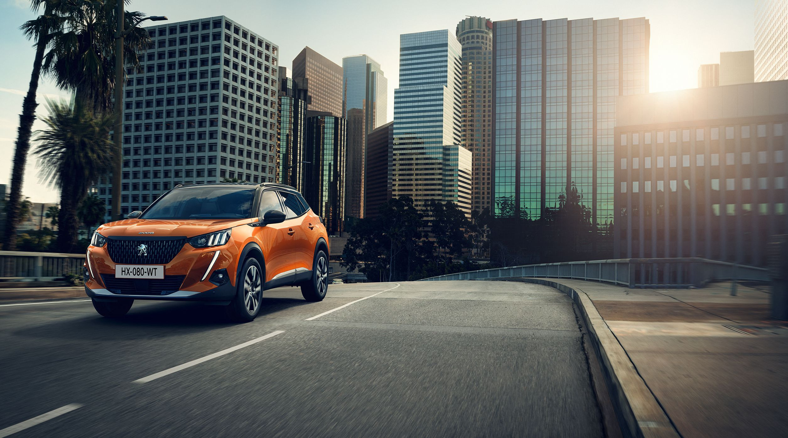Orange Peugeot 2008 driving on a road