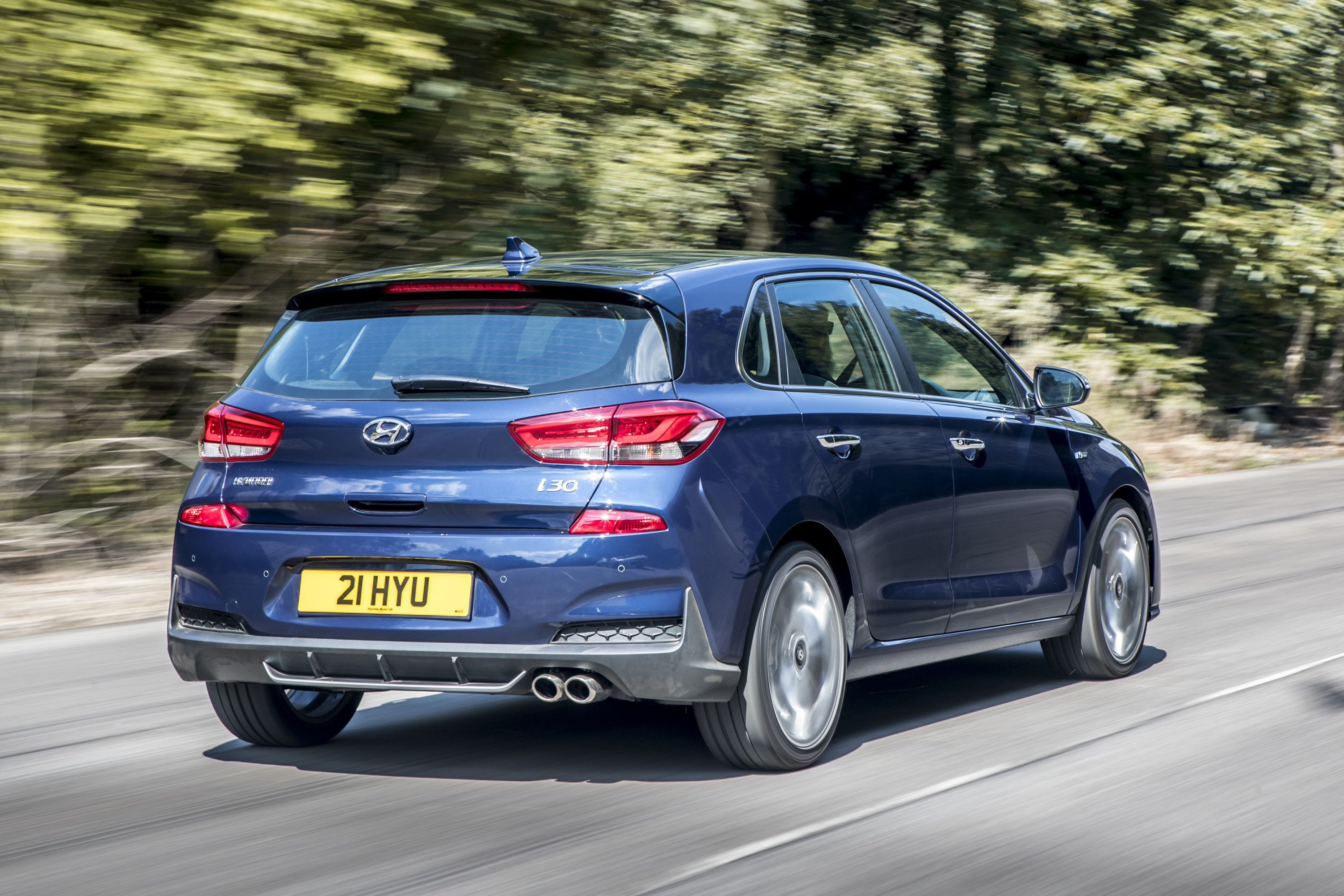 Rear view of Hyundai I30 N-line driving on a road
