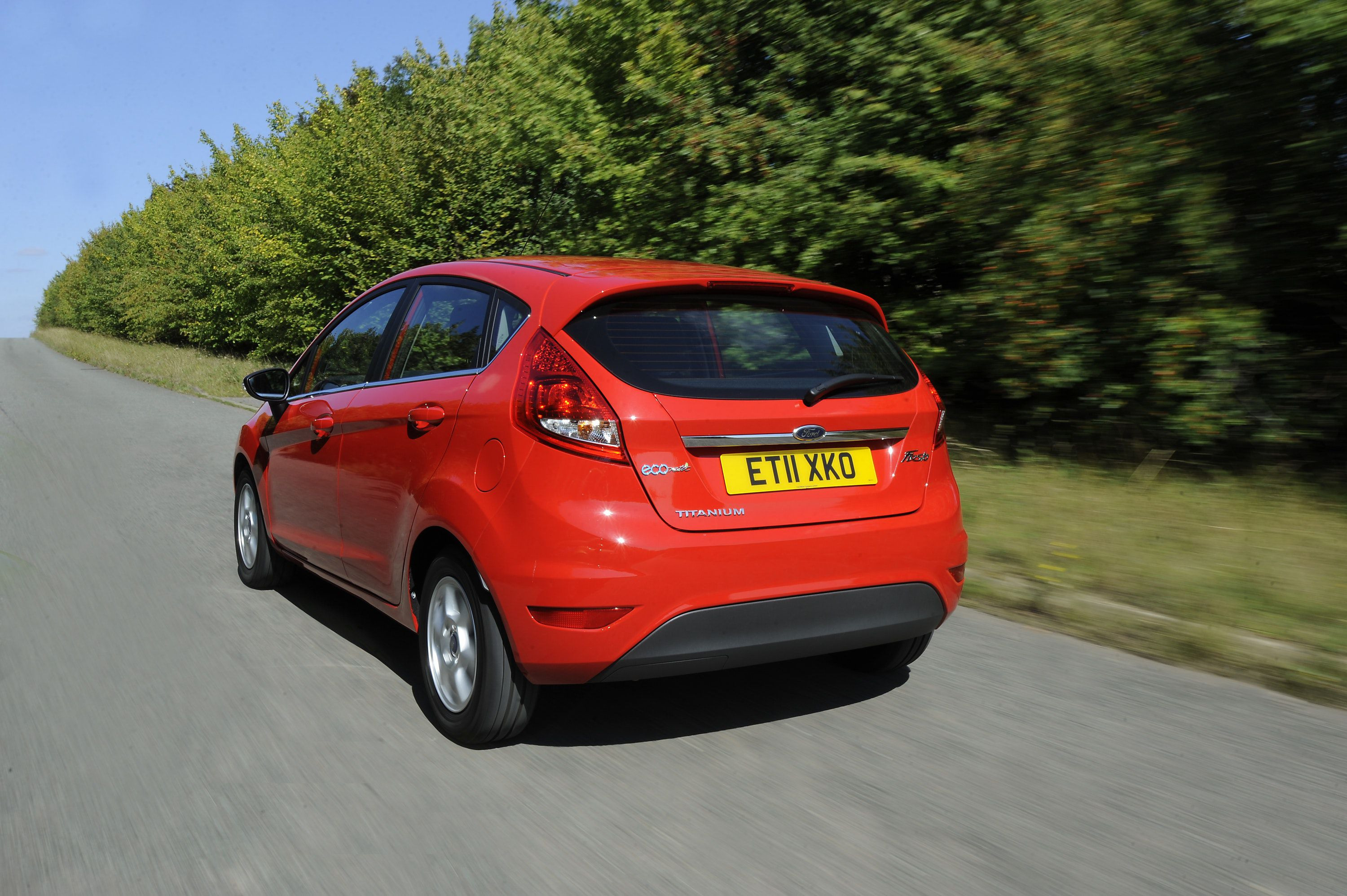 Rear view of a Ford Fiesta driving on a road