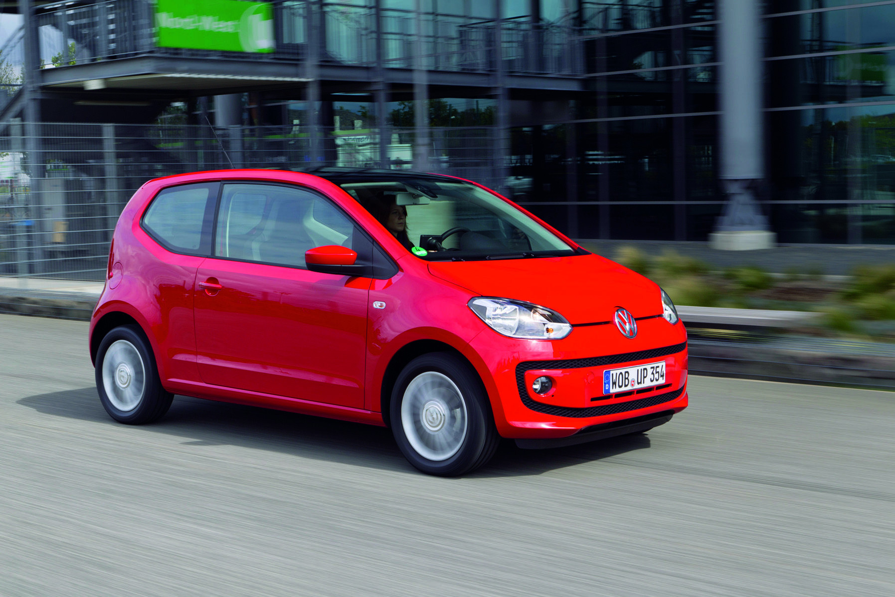 Red VW Up! driving on a road