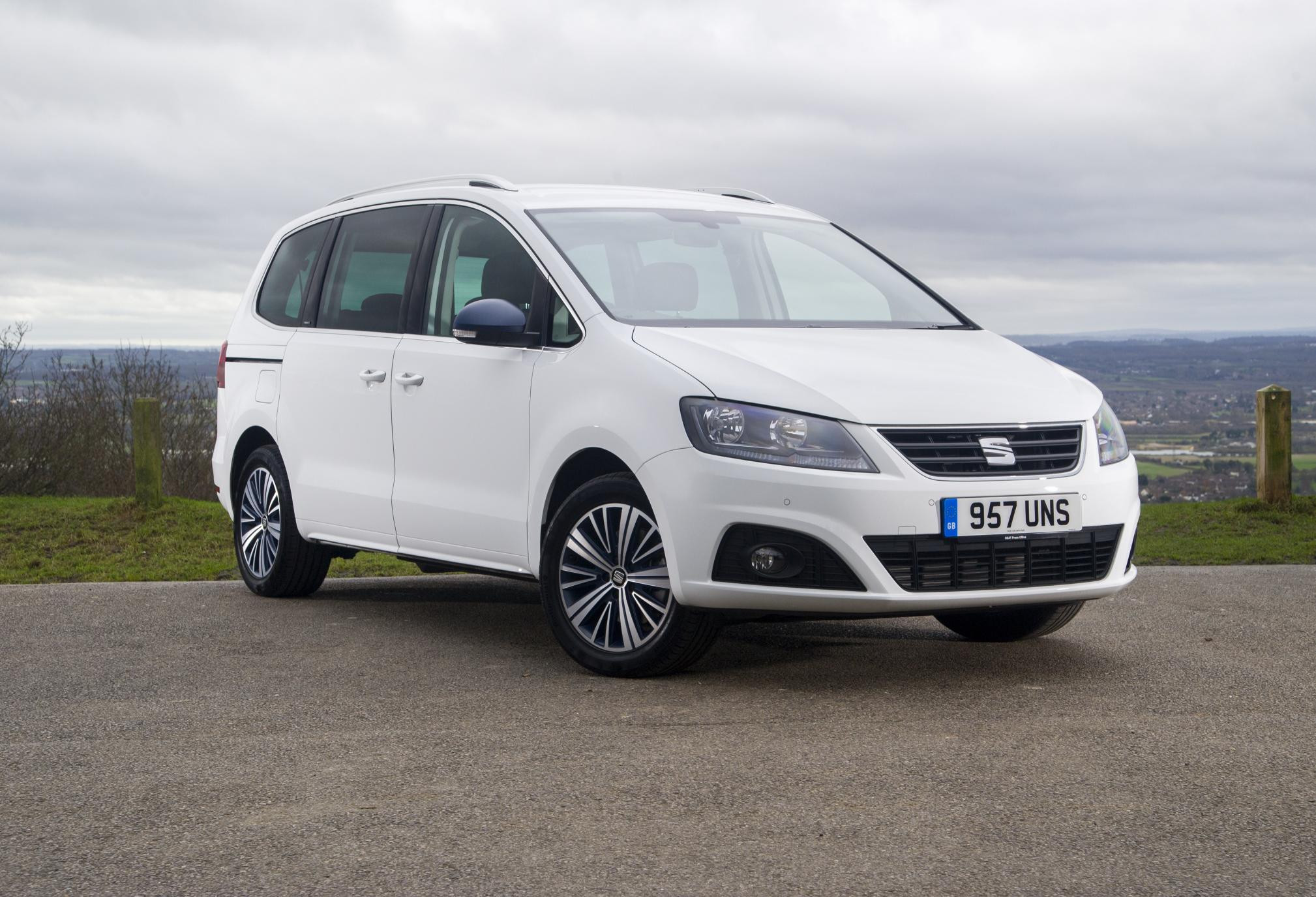 White SEAT Alhambra parked on tarmac and facing three-quarters to right