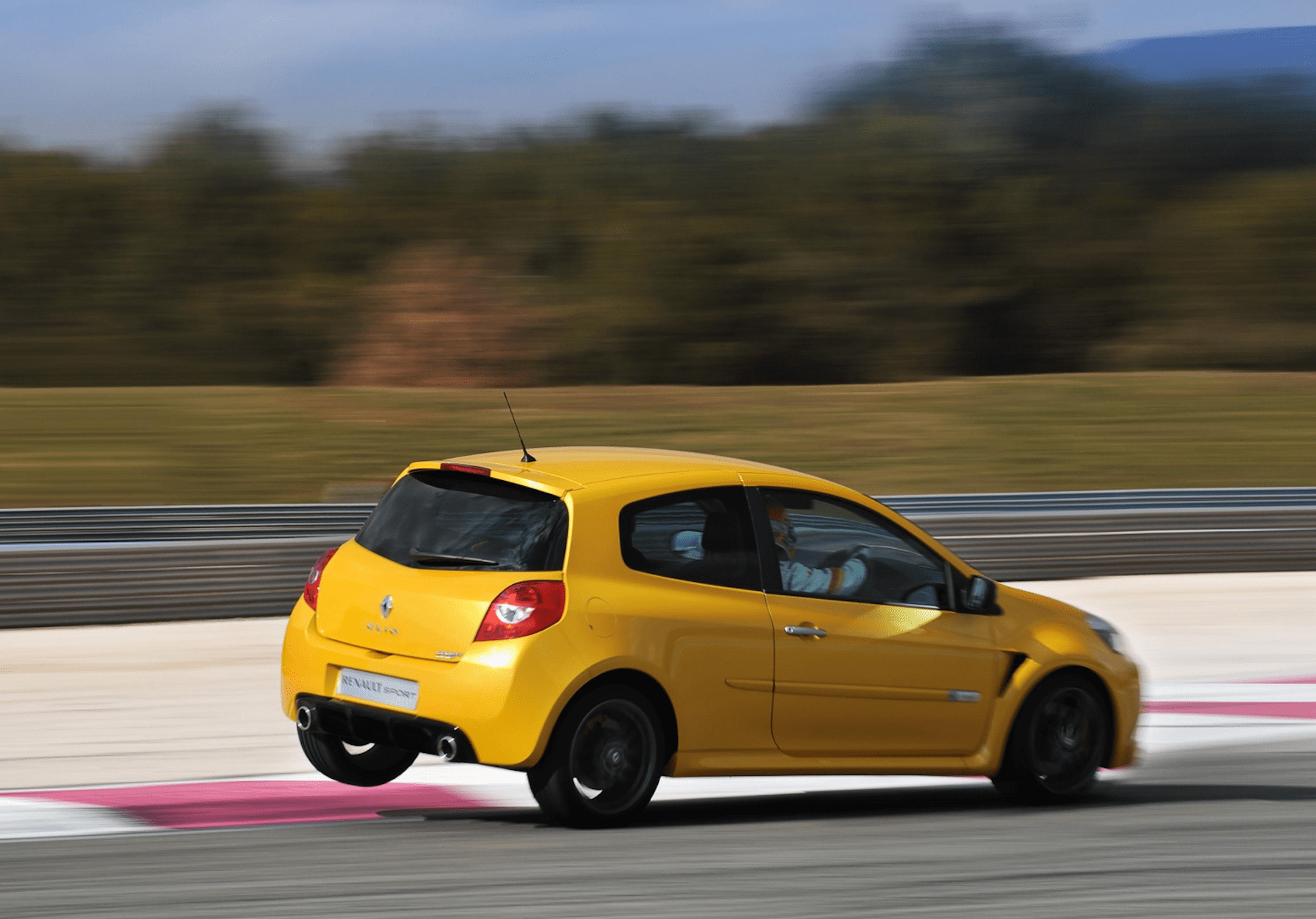 Renaultsport Clio in yellow driving around a racetrack