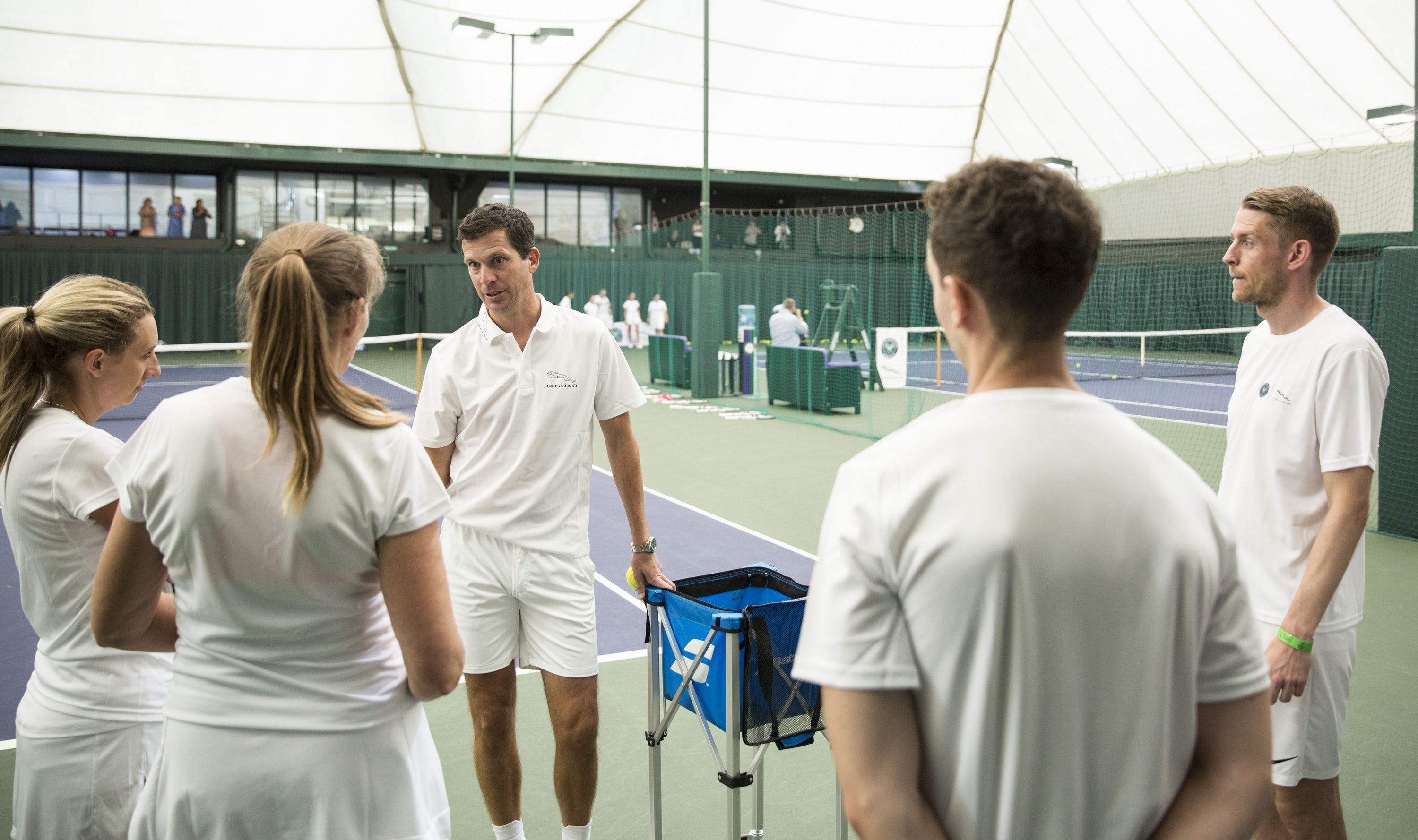 Tim Henman talking to tennis players