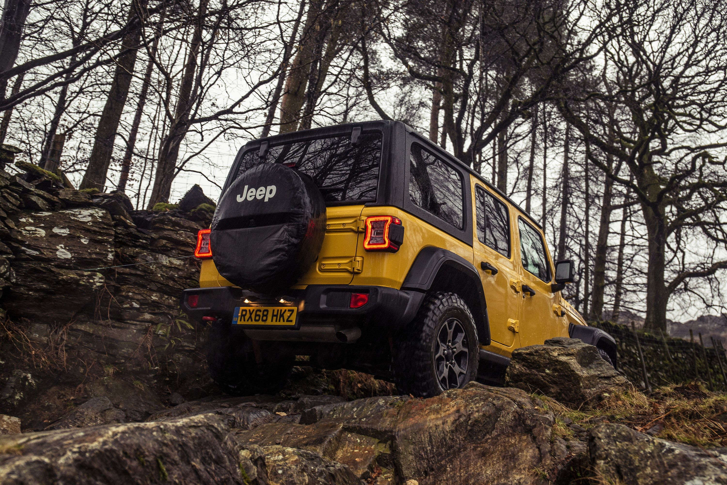 Jeep Wrangler driving on rocky roads