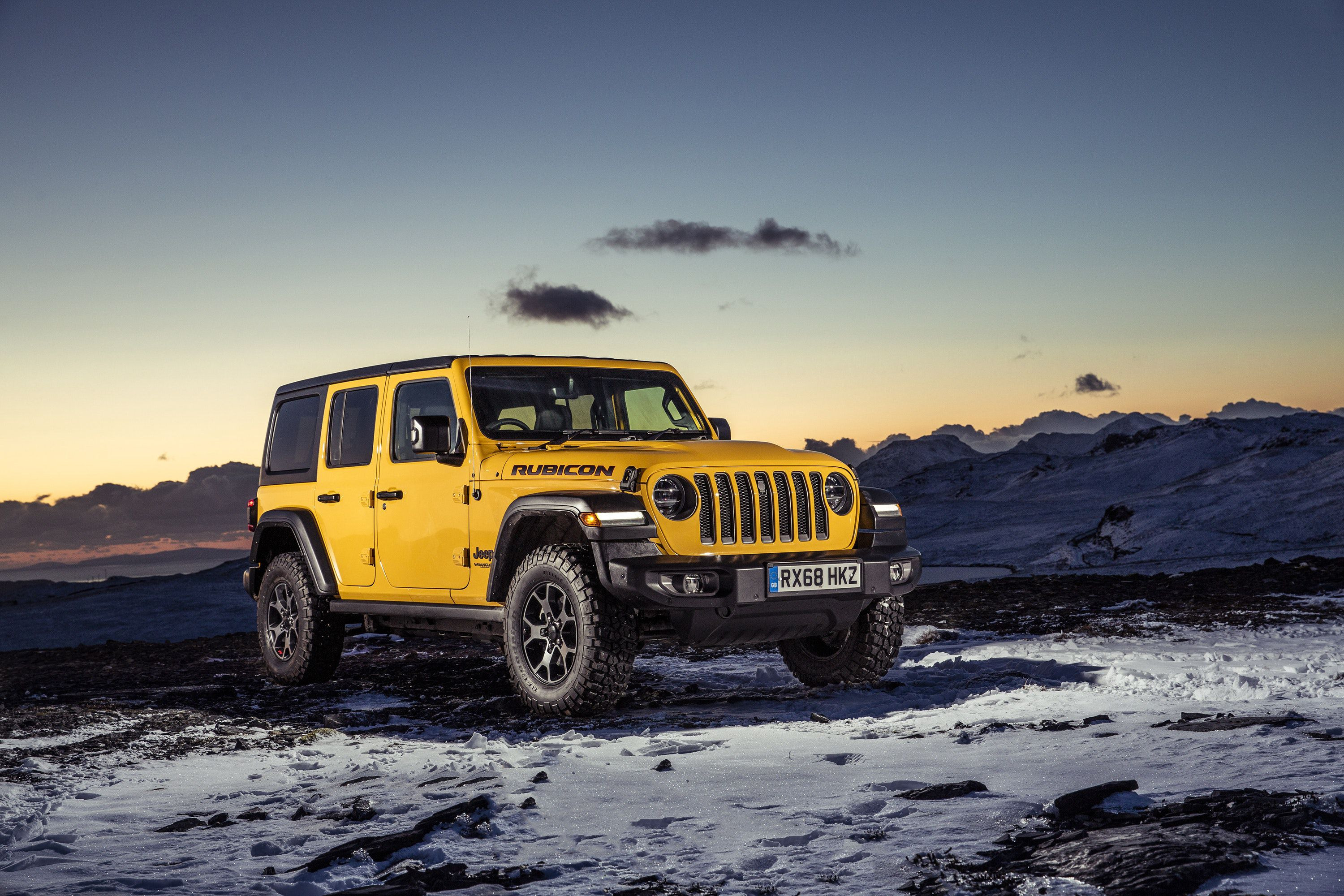 parked view of yellow Jeep Wrangler