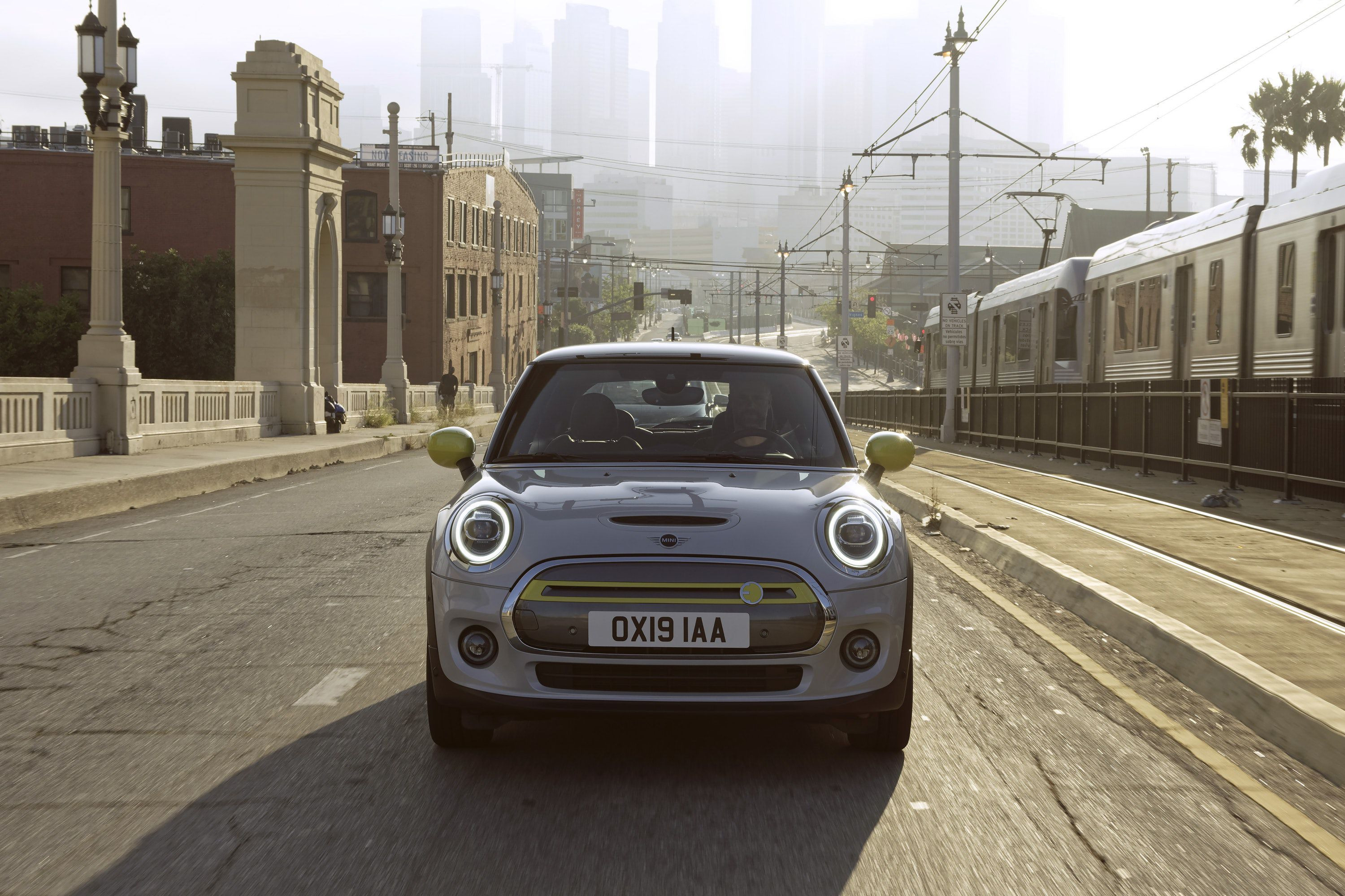 Front view of a Mini driving on a road