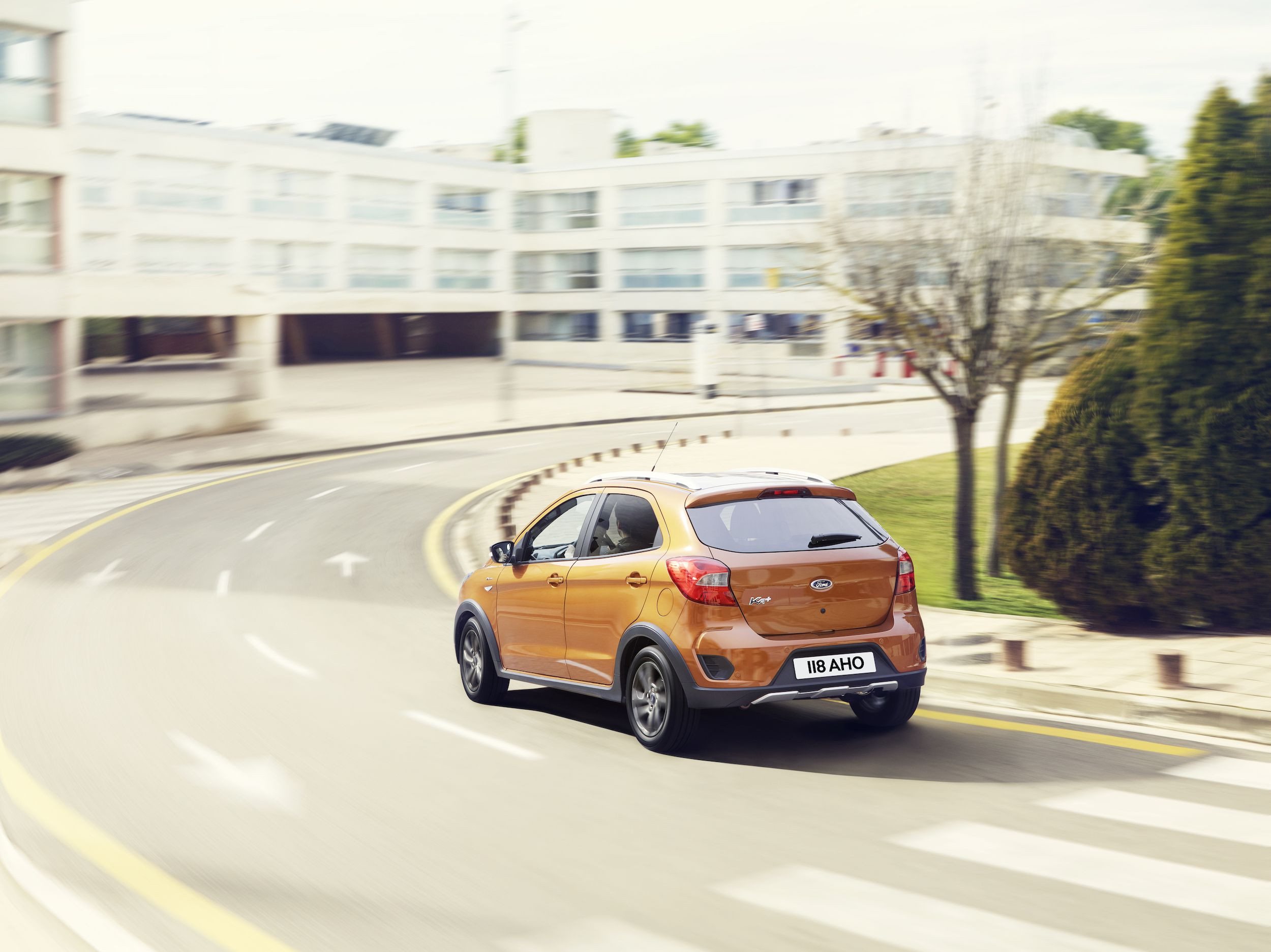 rear view of orange Ford Ka Active driving on a road