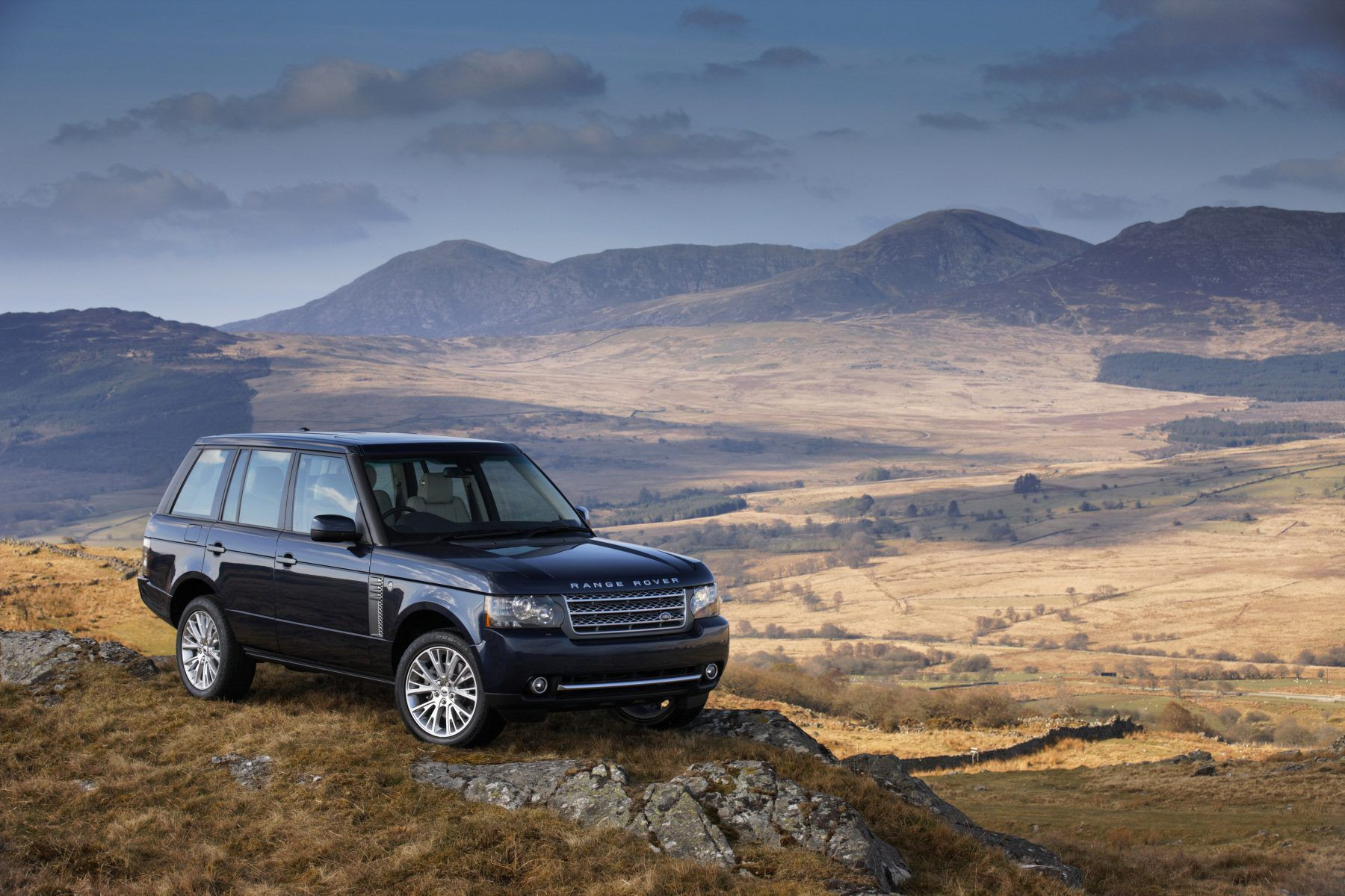 Black Range Rover on a hill