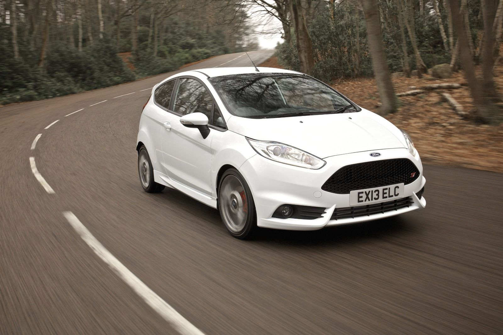 white Ford Fiesta ST driving on a road