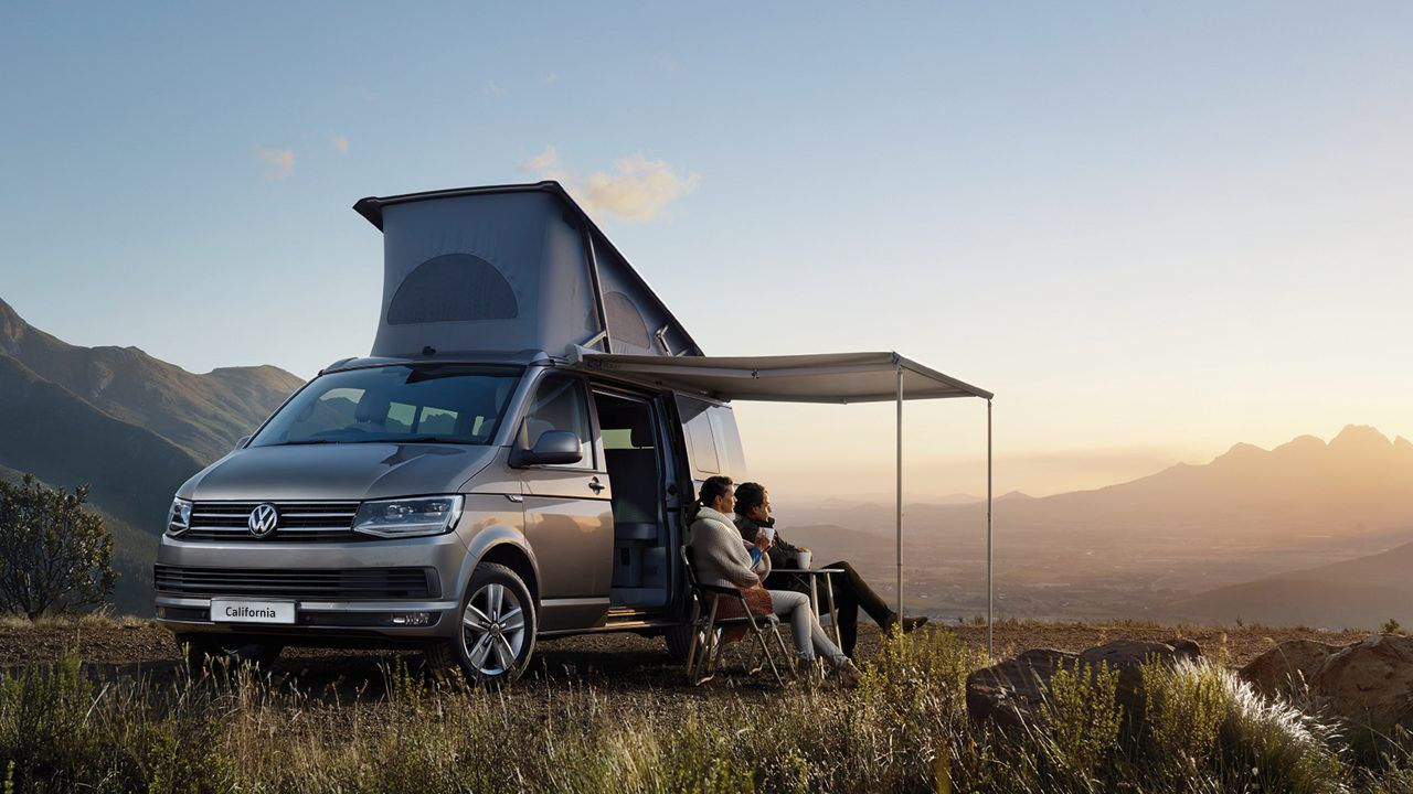 VW California with awning and picnic table out in beautiful location