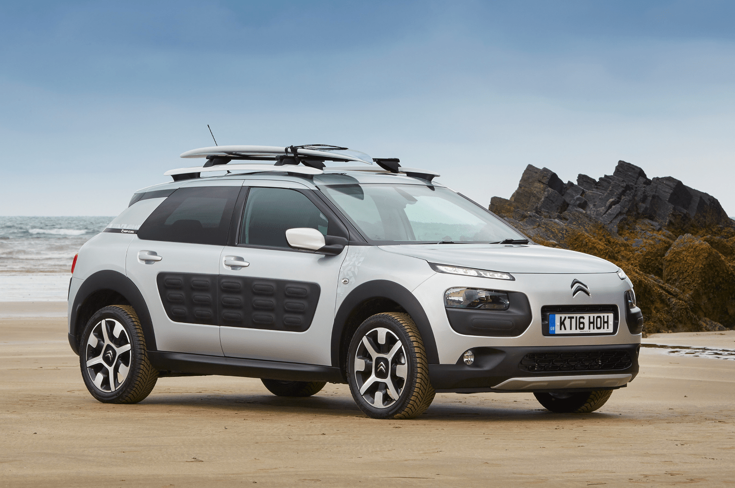 Silver Citroen C4 Cactus parked on a beach