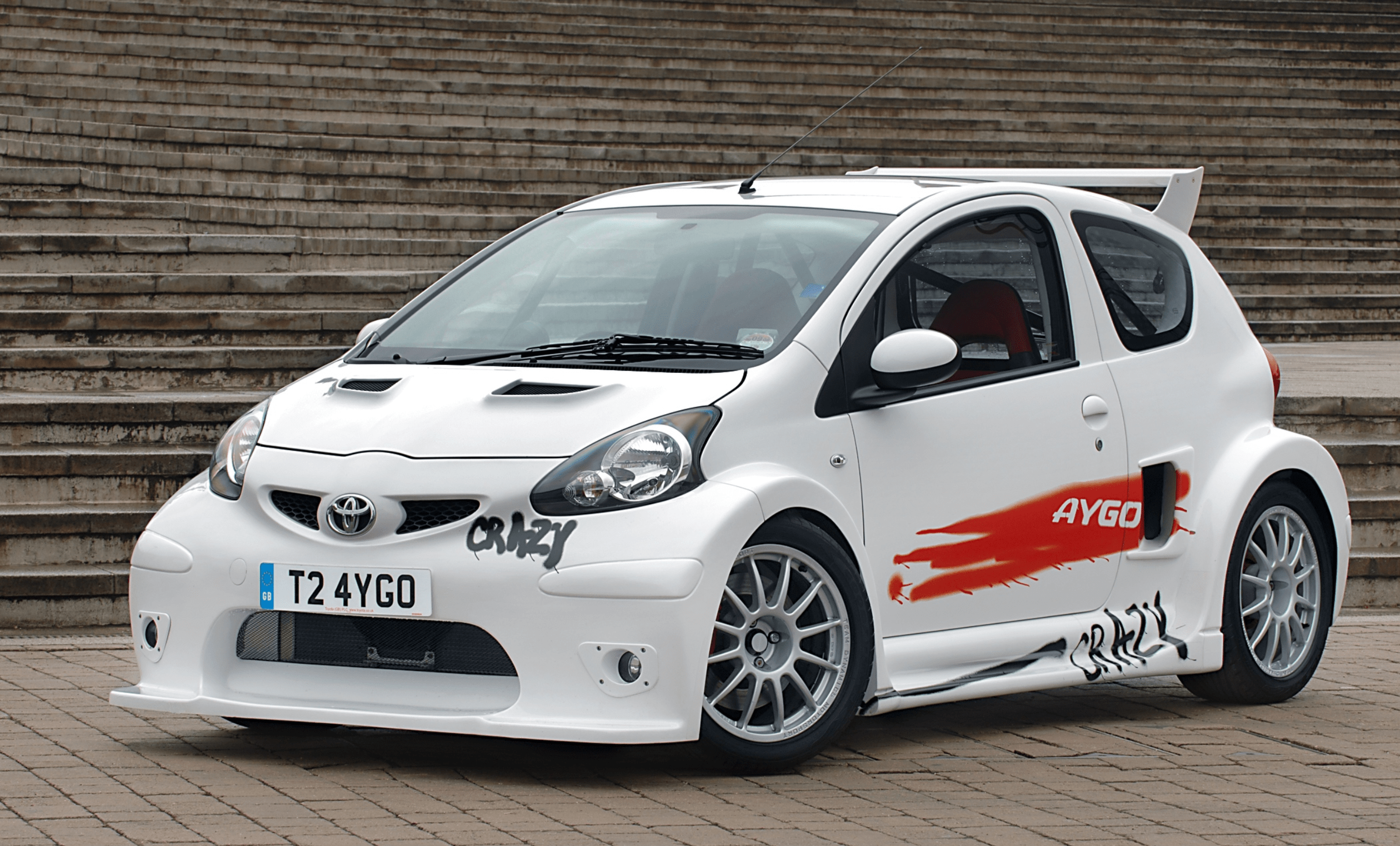 Toyota Aygo with a sports kit and spray paint graffiti saying Crazy and Aygo