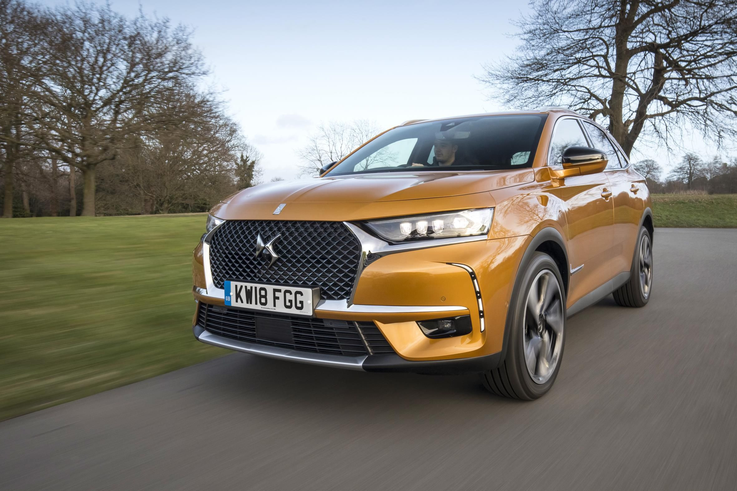 Bright pale orange DS 7 Crossback driving towards you