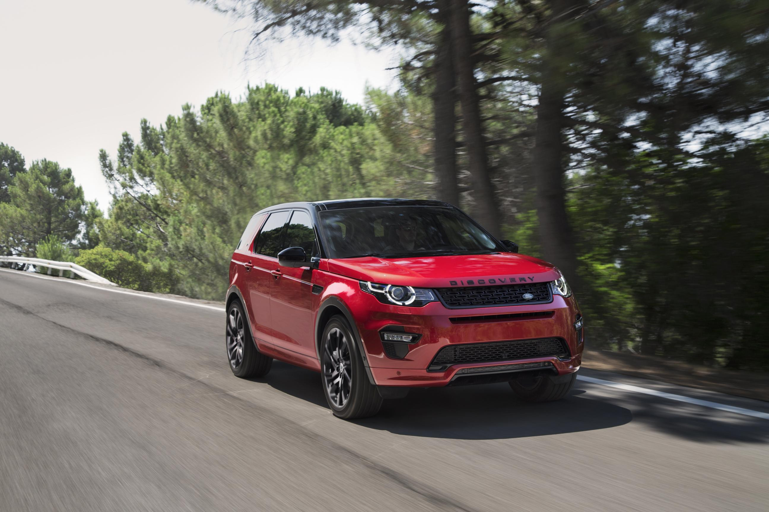 Red Land Rover Discovery Sport driving towards you