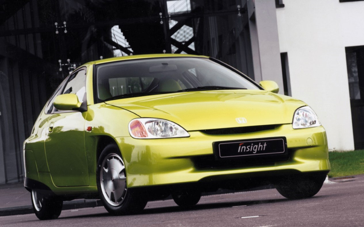 Citrus yellow metallic electric Honda Insight driving on the road