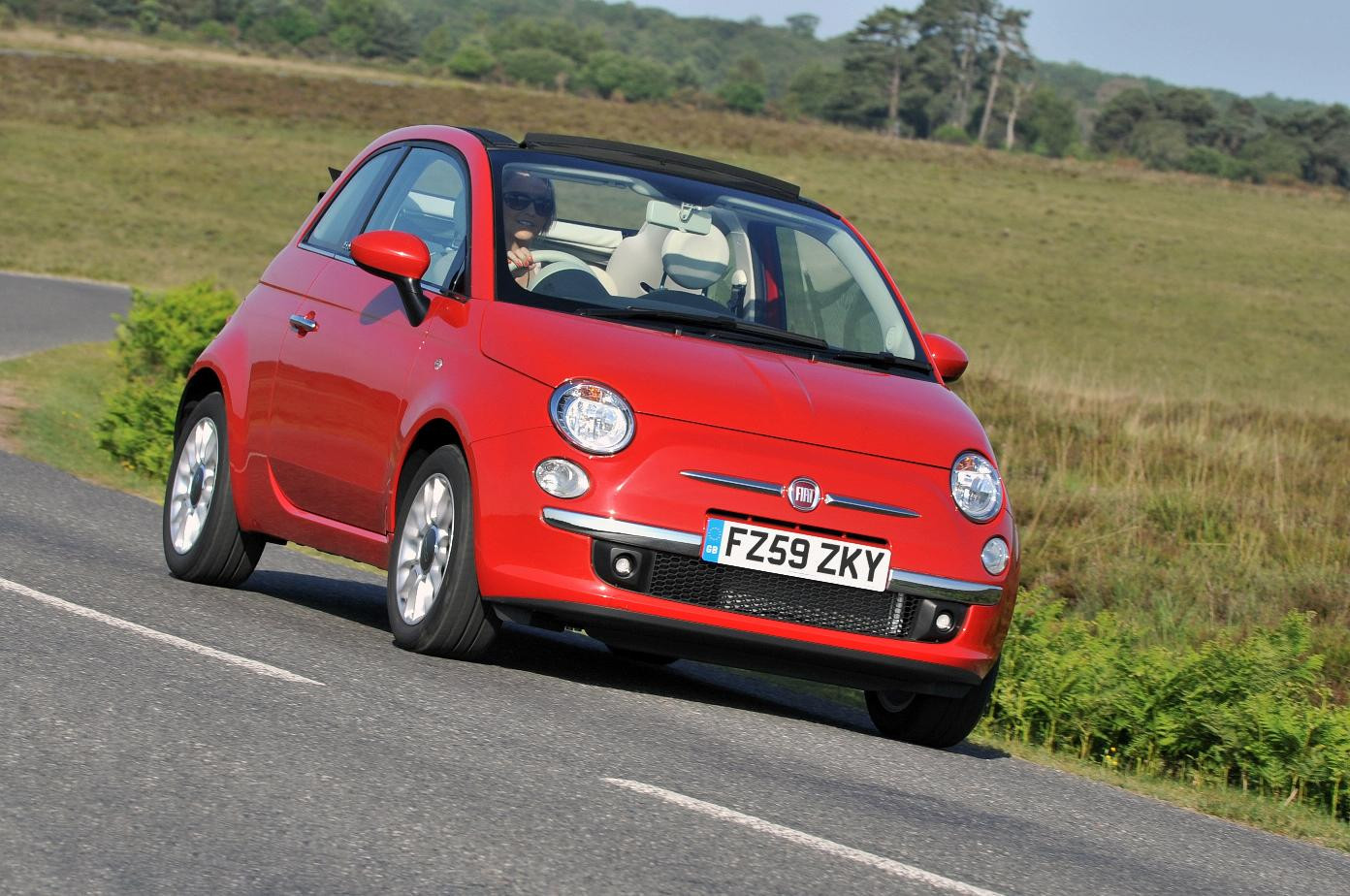 Red Fiat 500C driving towards you